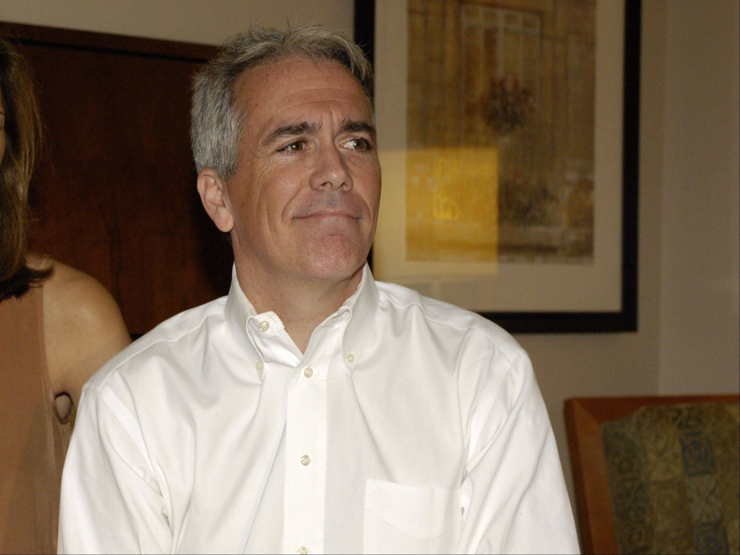8th District Congressman Joe Walsh watches election returns with his family at the Hilton Garden Inn in Addison. Walsh lost to challenger Tammy Duckworth.