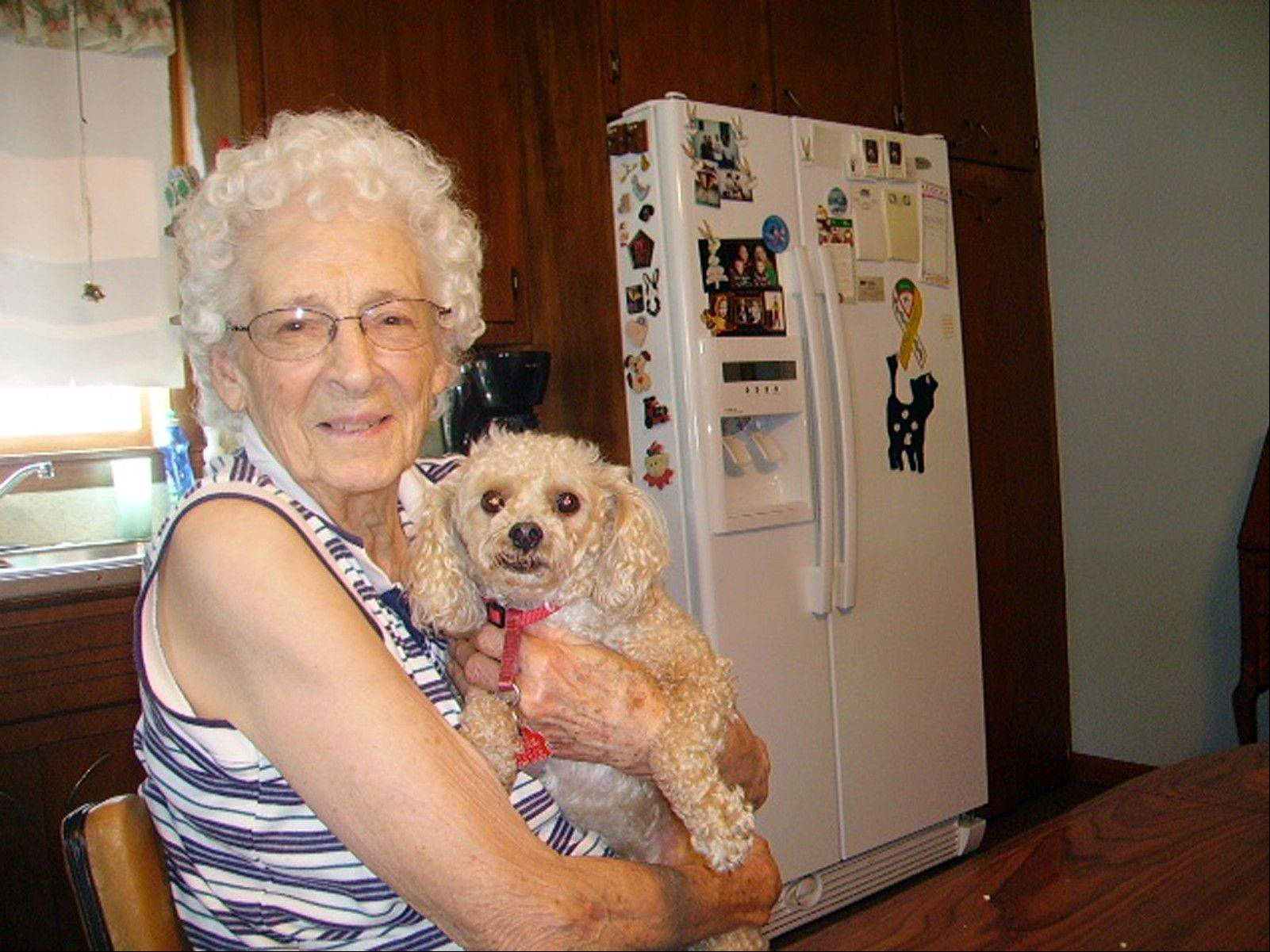 This photo provided by Carol Snyder shows Pauline Burema holding her dog, Lucky. Burema was the first person to die in Indiana from fungal meningitis. Lucky was Burema's long-time companion. Lucky is a male and is estimated at 8-10 years old with a life expectancy of 8-10 more years. The family provided the photograph in hopes of finding Lucky a new home.