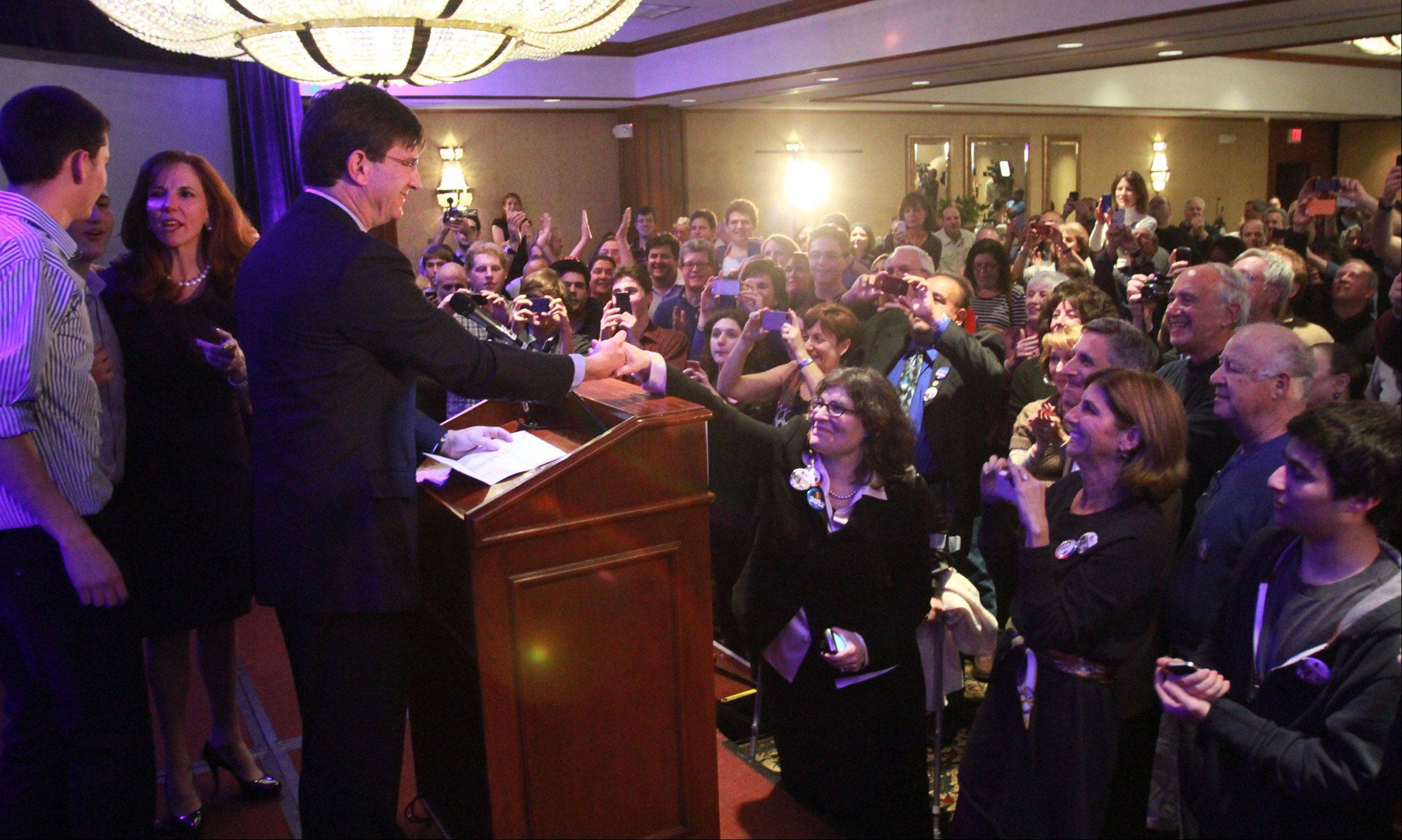 Brad Schneider with his wife, Julie Dann, and sons Adam and Daniel Schneider next to him Tuesday, speaks to supporters after winning the Illinois's 10th Congressional race.