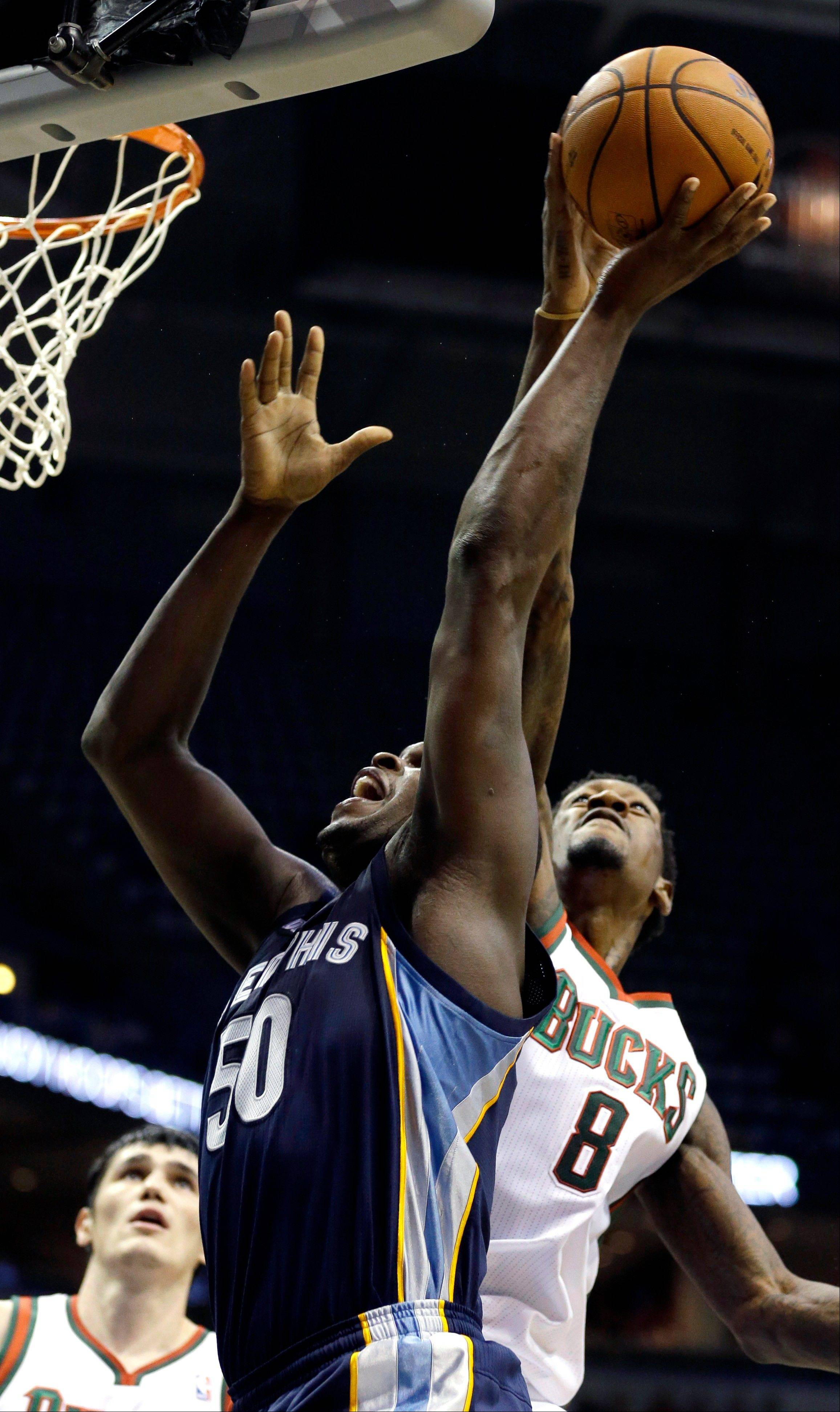 The Milwaukee Bucks Larry Sanders (8) blocks the shot of Memphis Grizzlies' Zach Randolph Wednesday during the first half in Milwaukee.