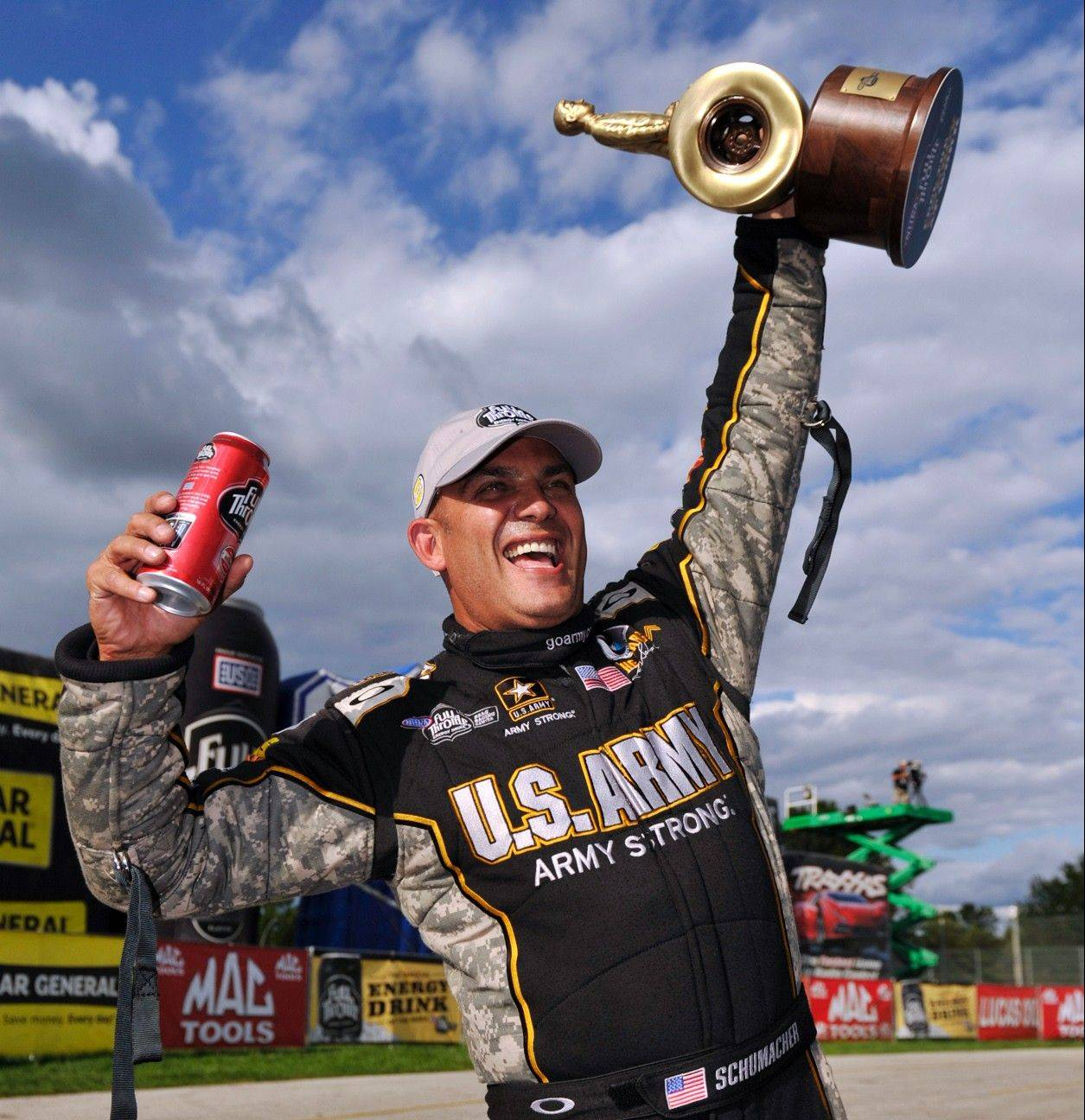 Tony Schumacher of Long Grove celebrates his record-breaking ninth Top Fuel win earlier this fall at the U.S. Nationals. He will vie with teammate Anton Brown for the title this weekend.