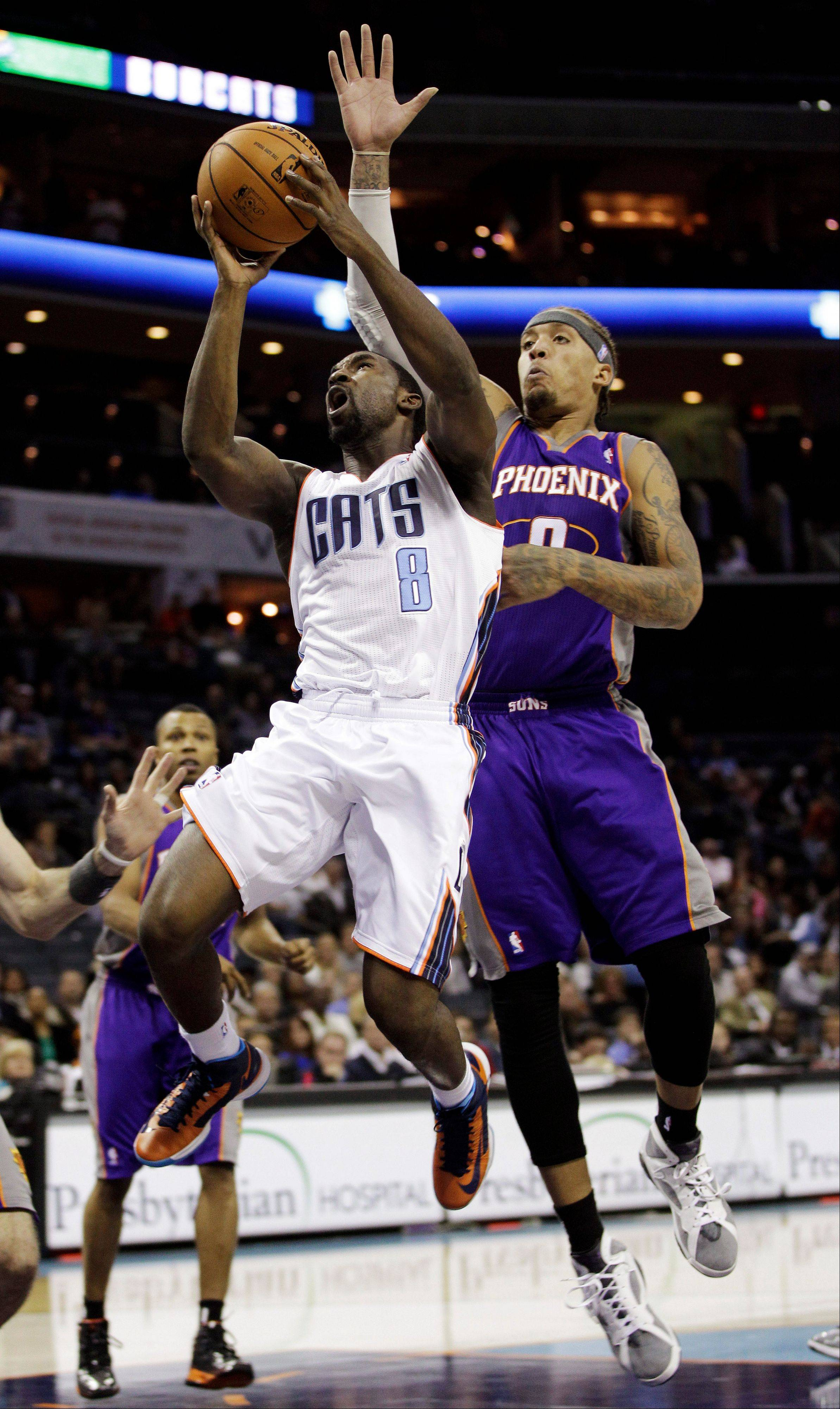 Charlotte Bobcats' Ben Gordon drives past Phoenix Suns' Michael Beasley Wednesday during the first half in Charlotte, N.C.