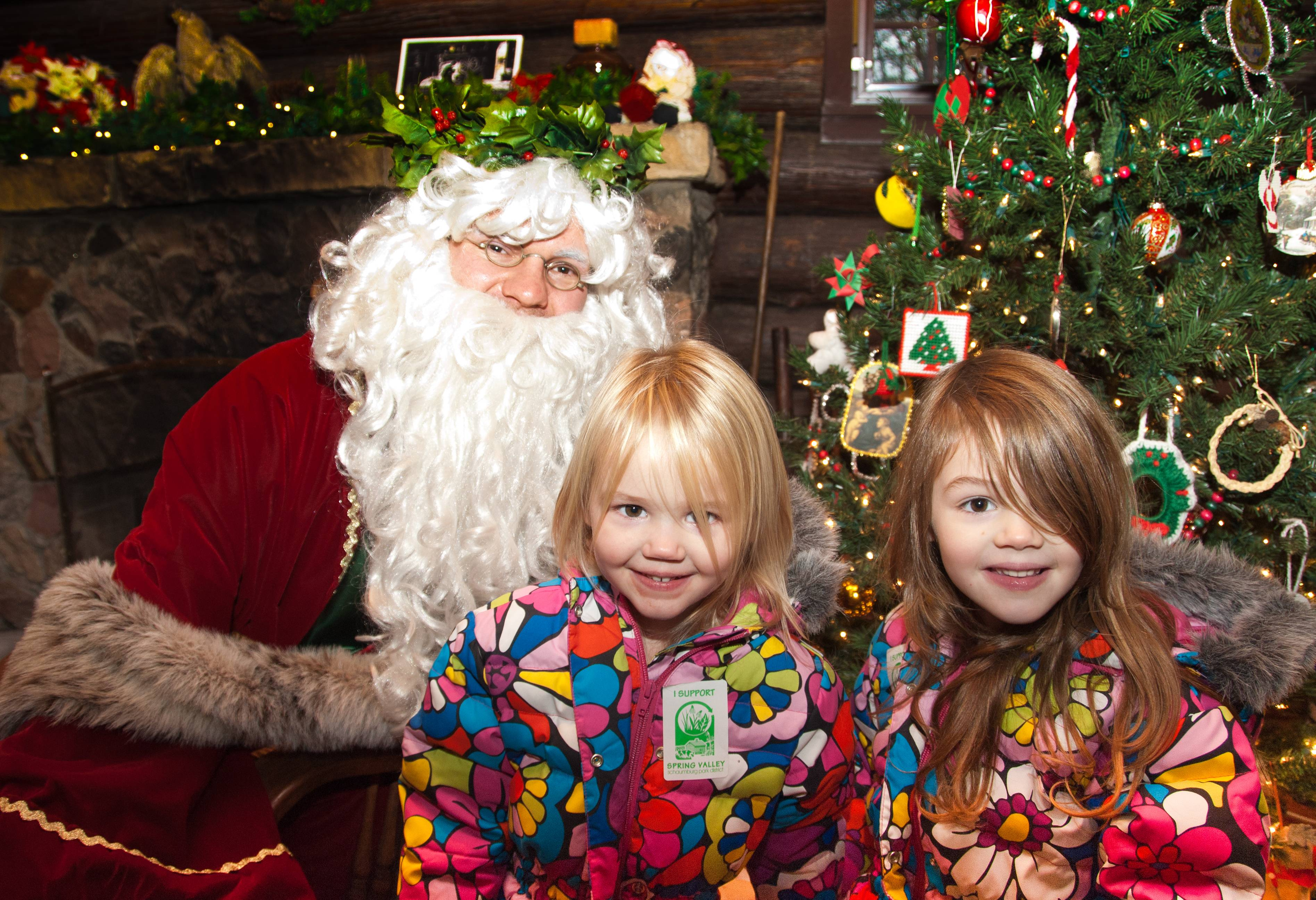 A traditional St. Nicholas meets with children at last year's Christmas in the Valley at Spring Valley's Merkle Log Cabin.