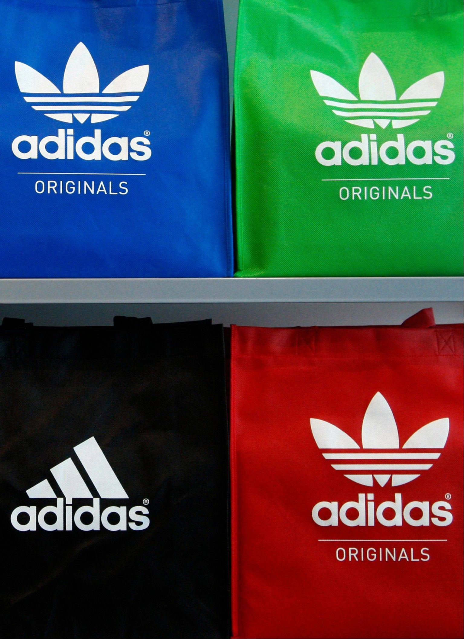 Adidas AG, the world�s second-biggest sporting-goods maker, cut its sales forecast for the year on lower sales expectations for its Reebok brand.