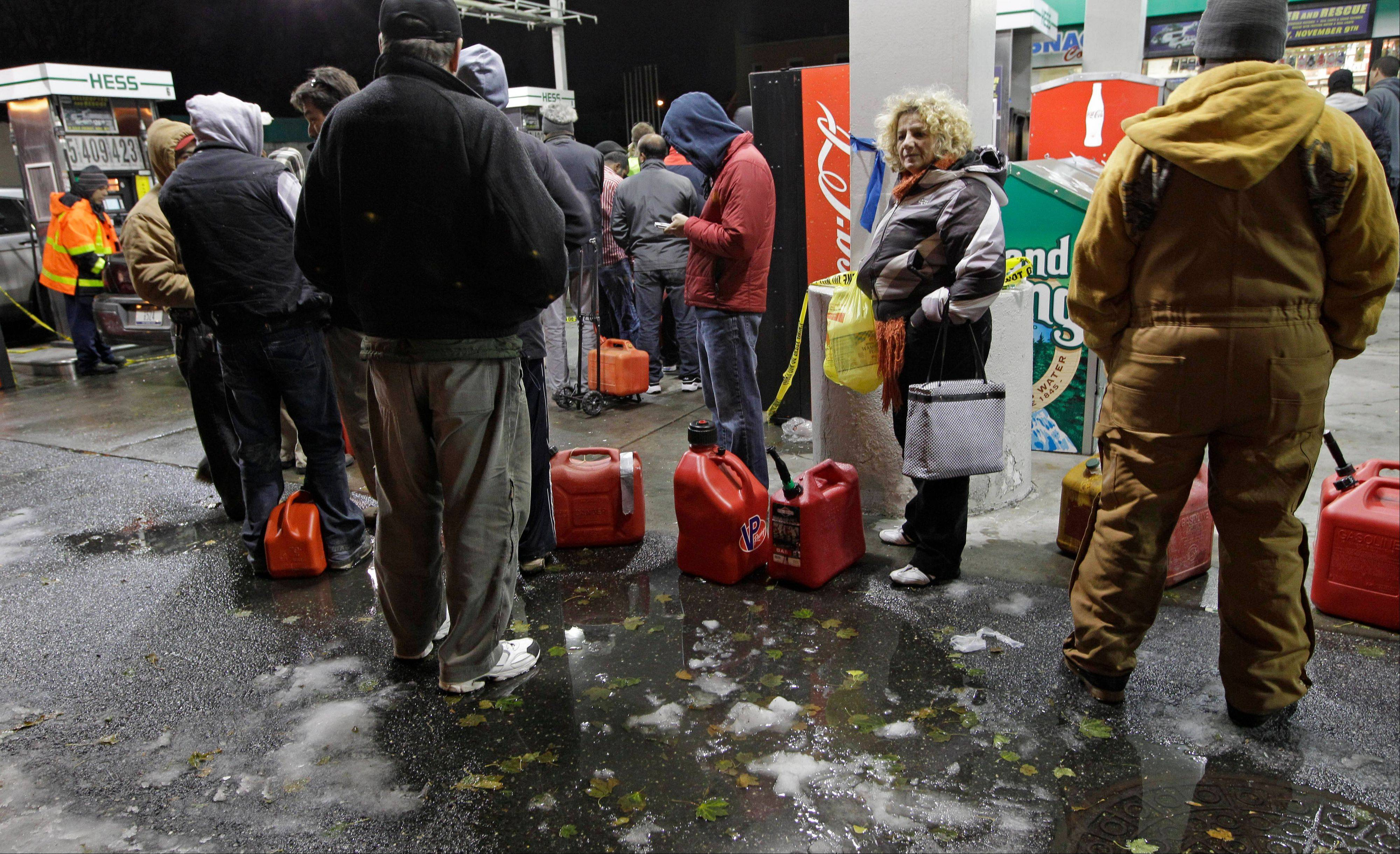 People wait in line for gasoline in Brooklyn, where gas is still scarce, Thursday. Fuel shortages and distribution delays that led to gas hoarding have prompted New York City and Long Island to initiate an even-odd gas rationing plan which begins Friday.