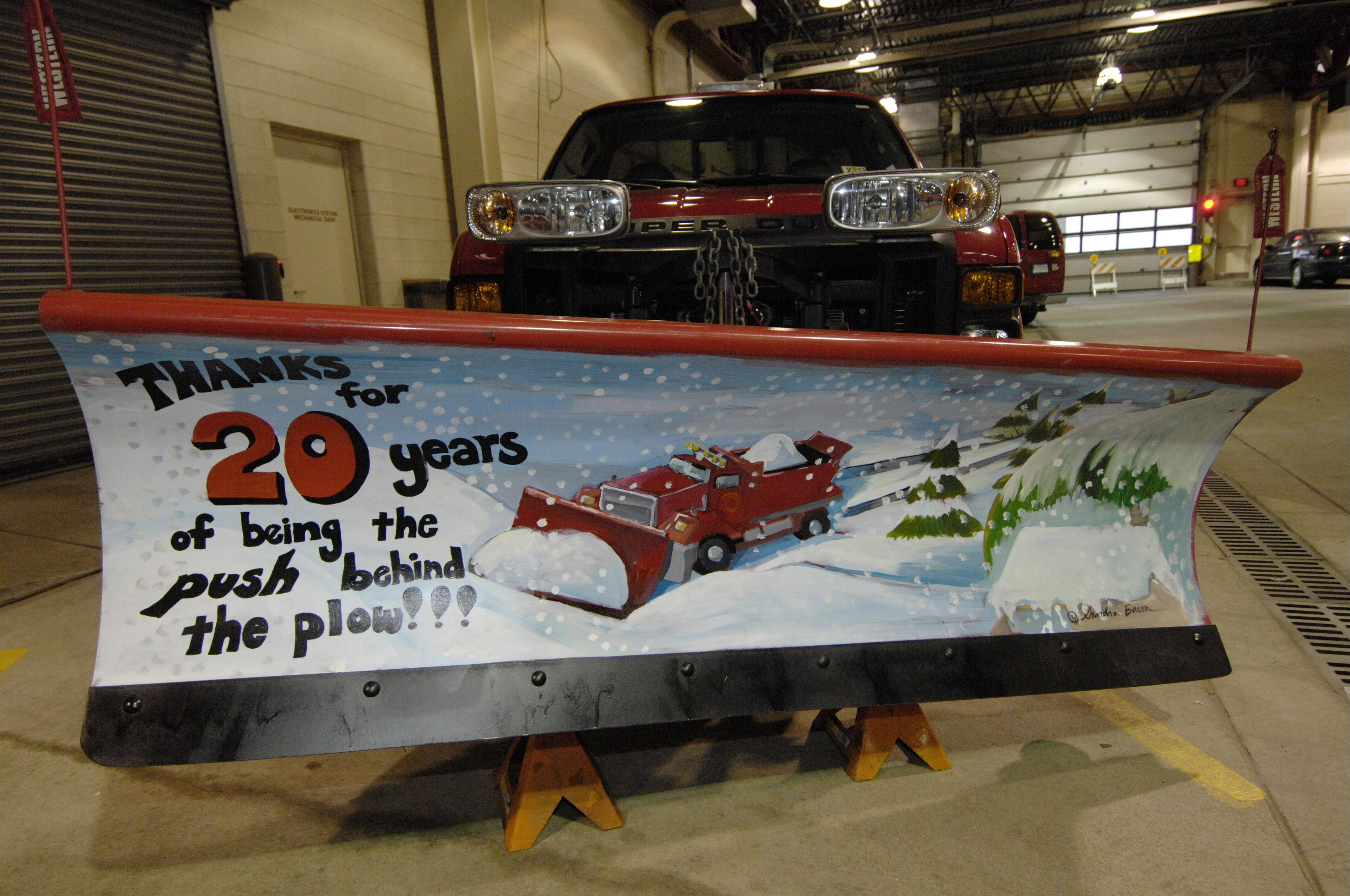An Arlington Heights snowplow is painted to recognize Mayor Arlene Mulder's 20 years in office.