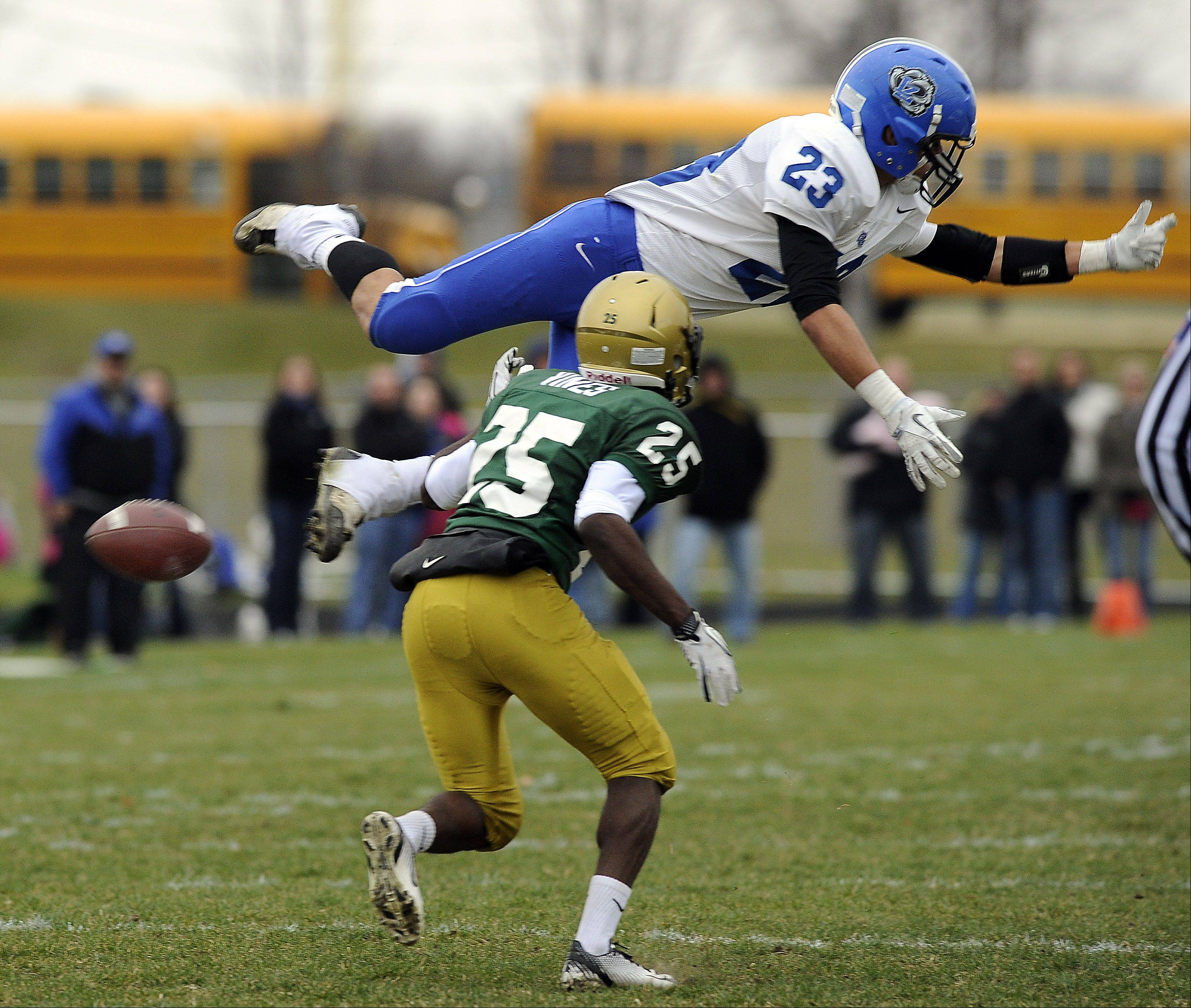 Lake Zurich�s Grant Soucy soars over Rockford Boylan�s DeMarcus Vines during the second quarter of the teams� Class 7A state semifinal matchup last season in Rockford. This year they�re meeting in the quarterfinals, at 1 p.m. Saturday at Lake Zurich, with both Soucy and Vines again key players for their teams.