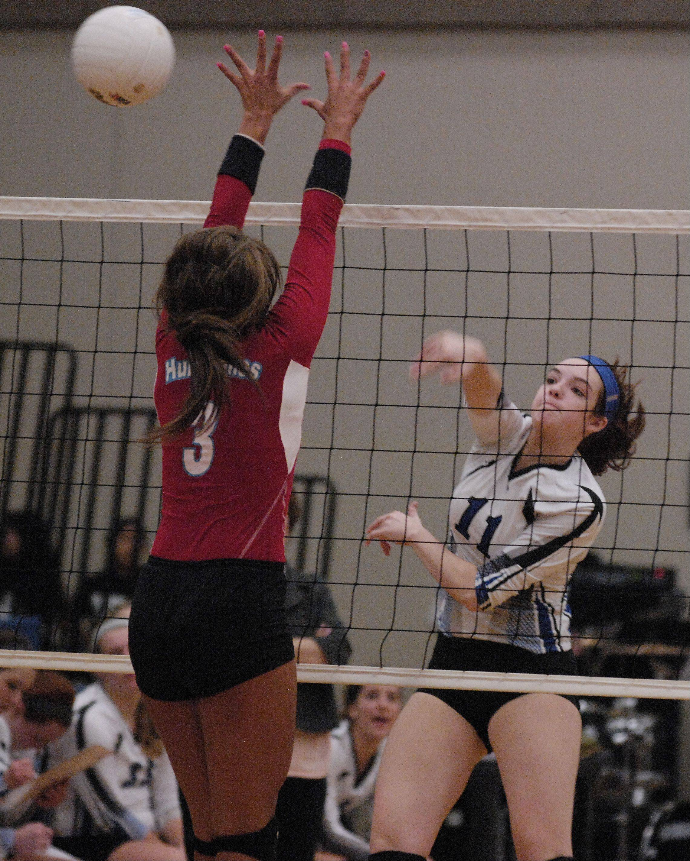 Becca Shearer of St. Francis fires now past Frankie Taylor of Marian Central during girls volleyball action in Wheaton, Wednesday.