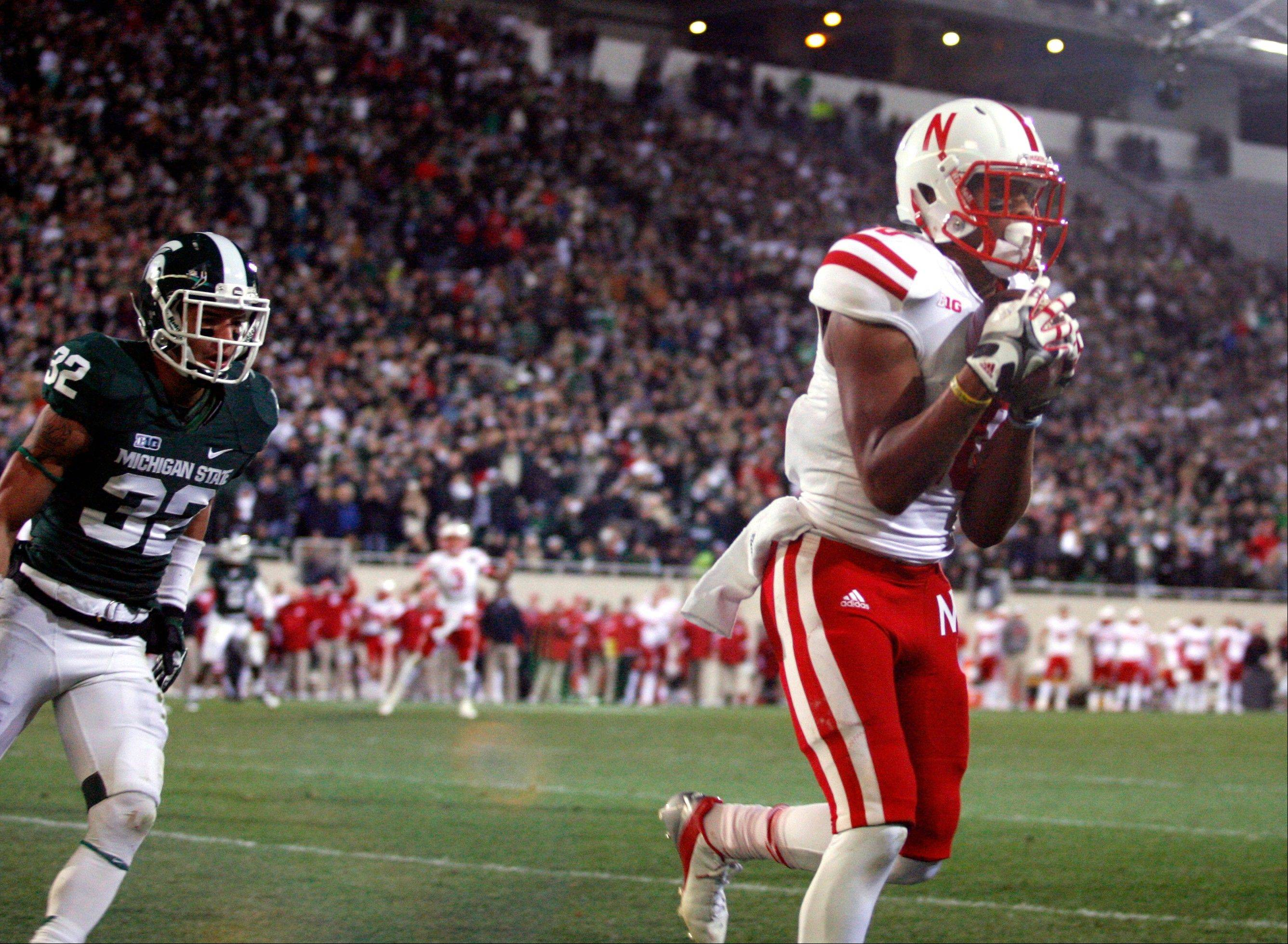 Nebraska�s Jamal Turner, right, catches the game-winning touchdown pass against Michigan State�s Mitchell White with seconds remaining in the fourth quarter Saturday in East Lansing, Mich. Nebraska won 28-24.