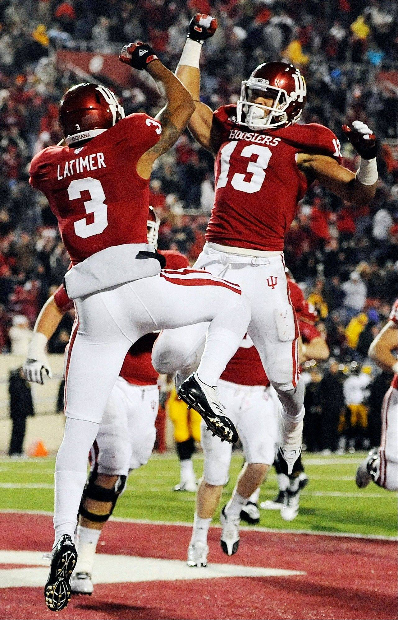 Indiana wide receiver Cody Latimer and wide receiver Kofi Hughes celebrate Latimer�s touchdown catch against Iowa Saturday during in Bloomington, Ind. Indiana won 24-21.
