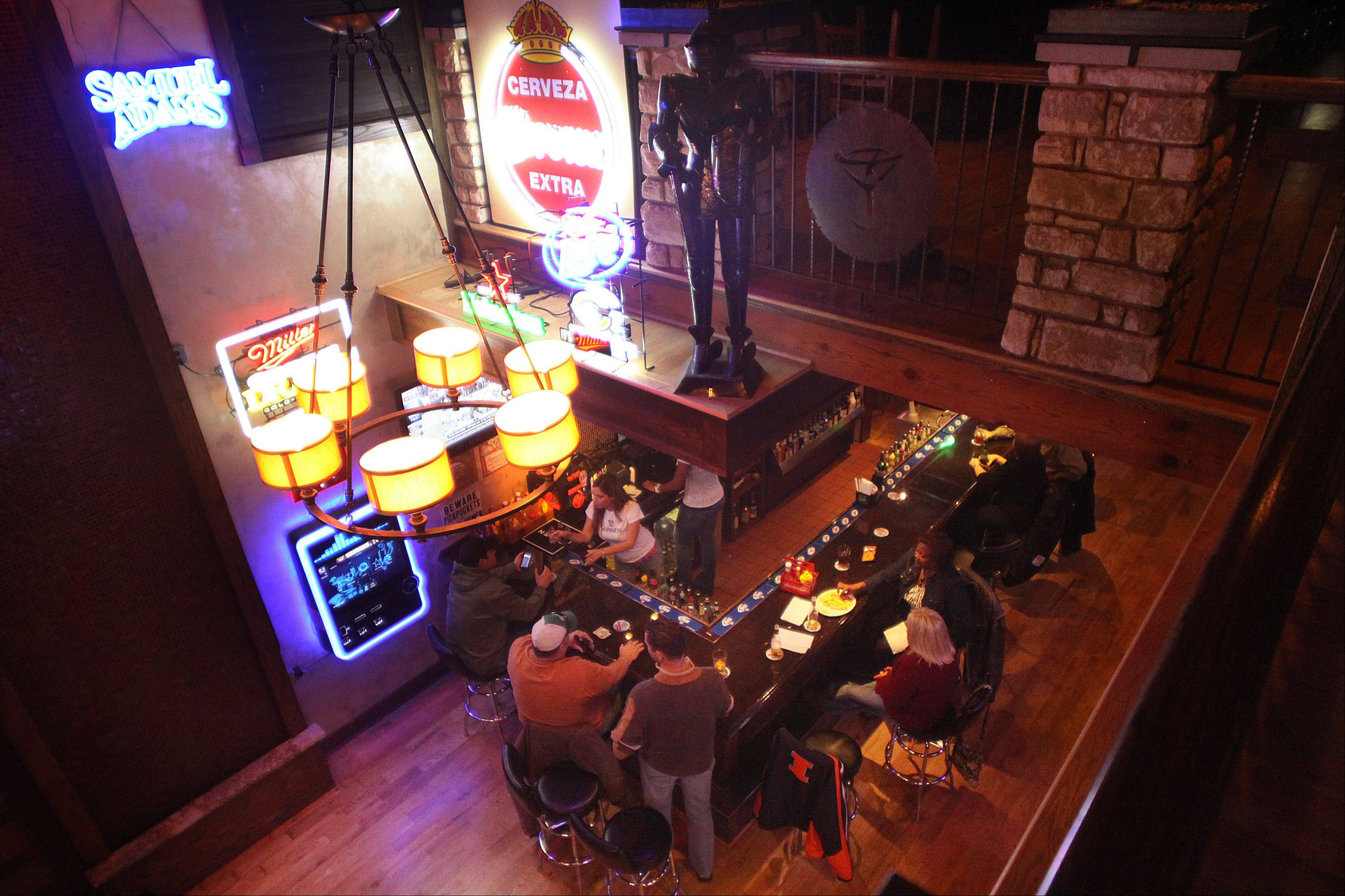 Patrons enjoy food and drinks at the Pour House Bar & Grill in East Dundee.