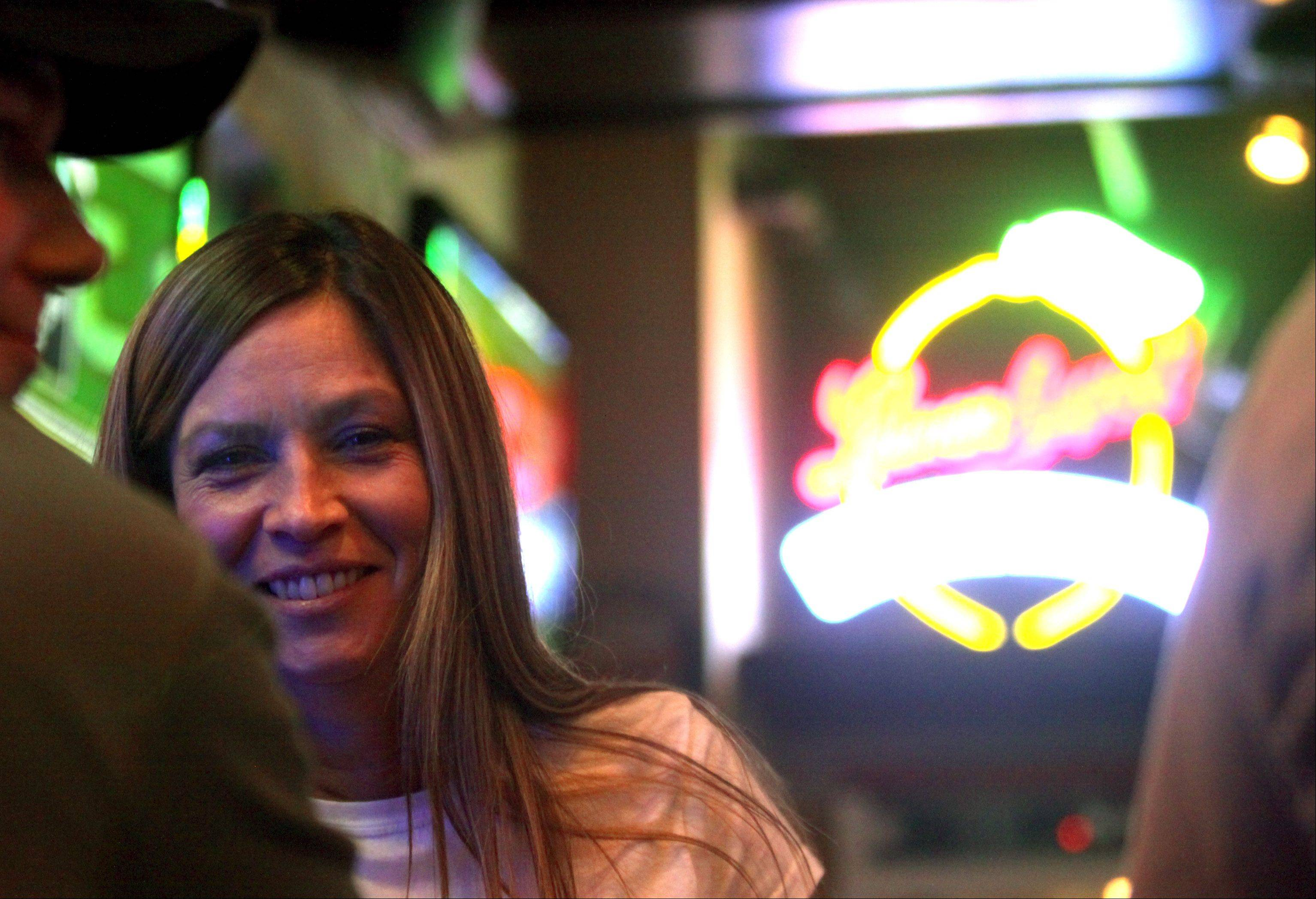 Bartender Carna Combest visits with patrons at the Pour House Bar & Grill in East Dundee.