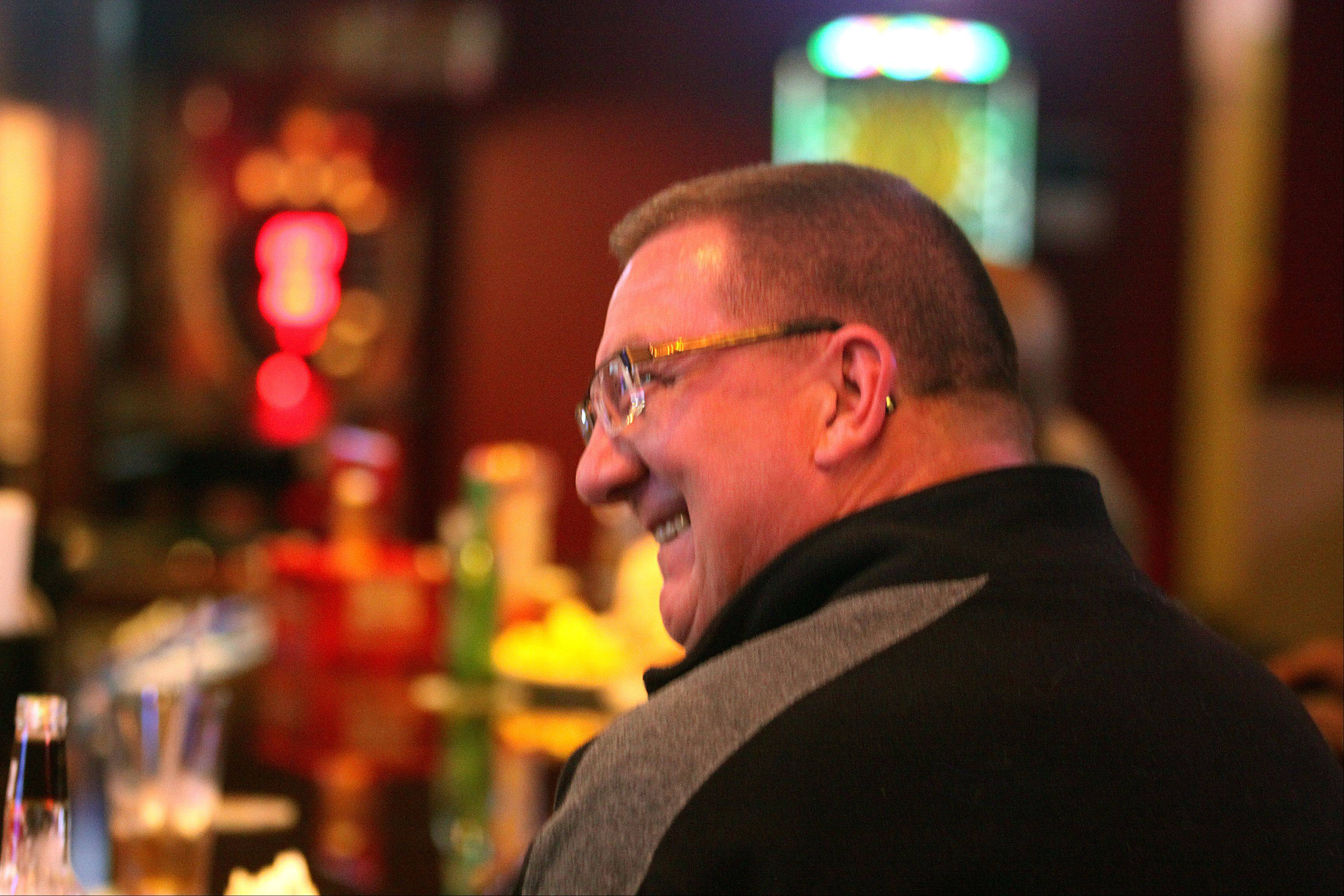 Gary Monson of Algonquin shares a laugh with others at the Pour House Bar & Grill in East Dundee.