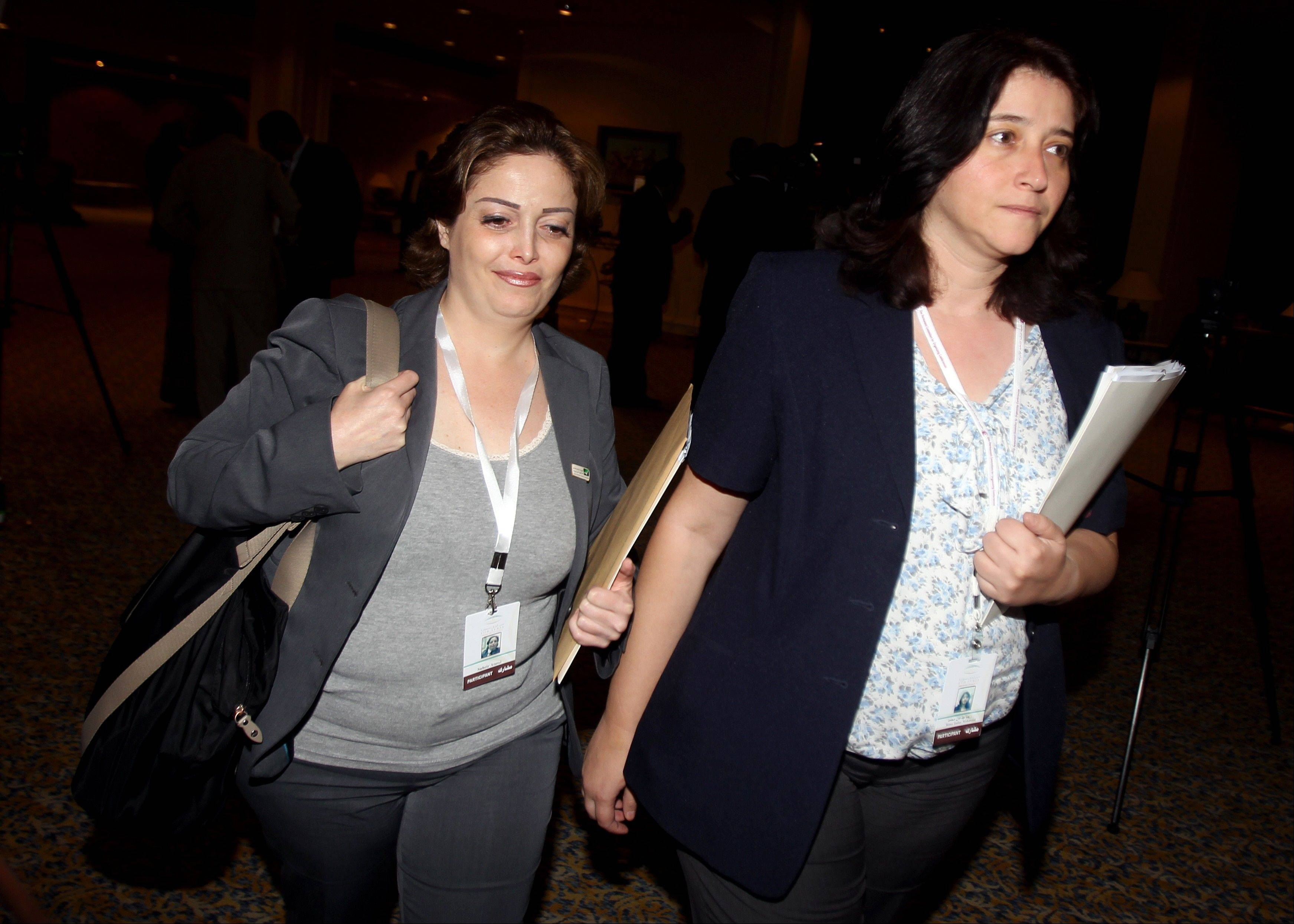 Syrian opposition members Suheir Atassi, left, and Rima Fleihan attend the meeting Thursday of the General Assembly of the Syrian National Council in Doha, Qatar.