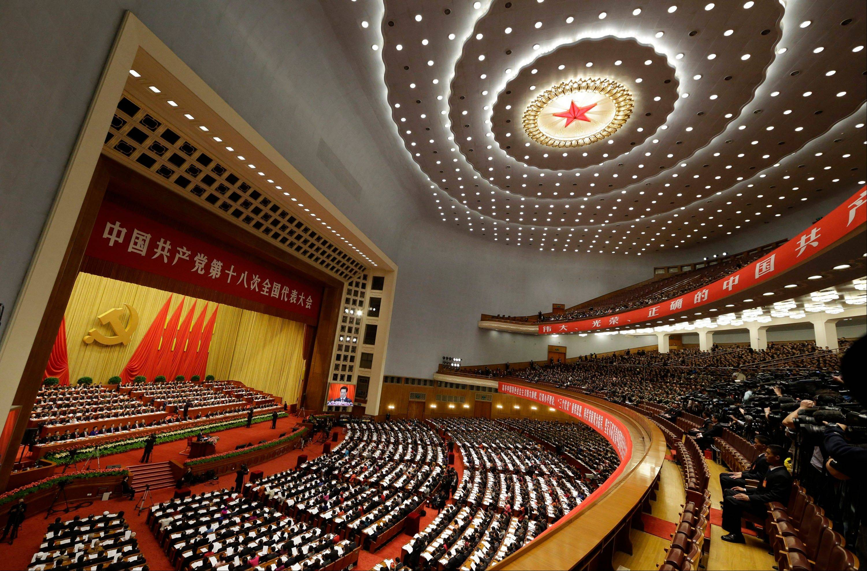 Chinese President Hu Jintao, center on the stage, addresses the opening session of the 18th Communist Party Congress held at the Great Hall of the People in Beijing, China, Thursday, Nov. 8, 2012.