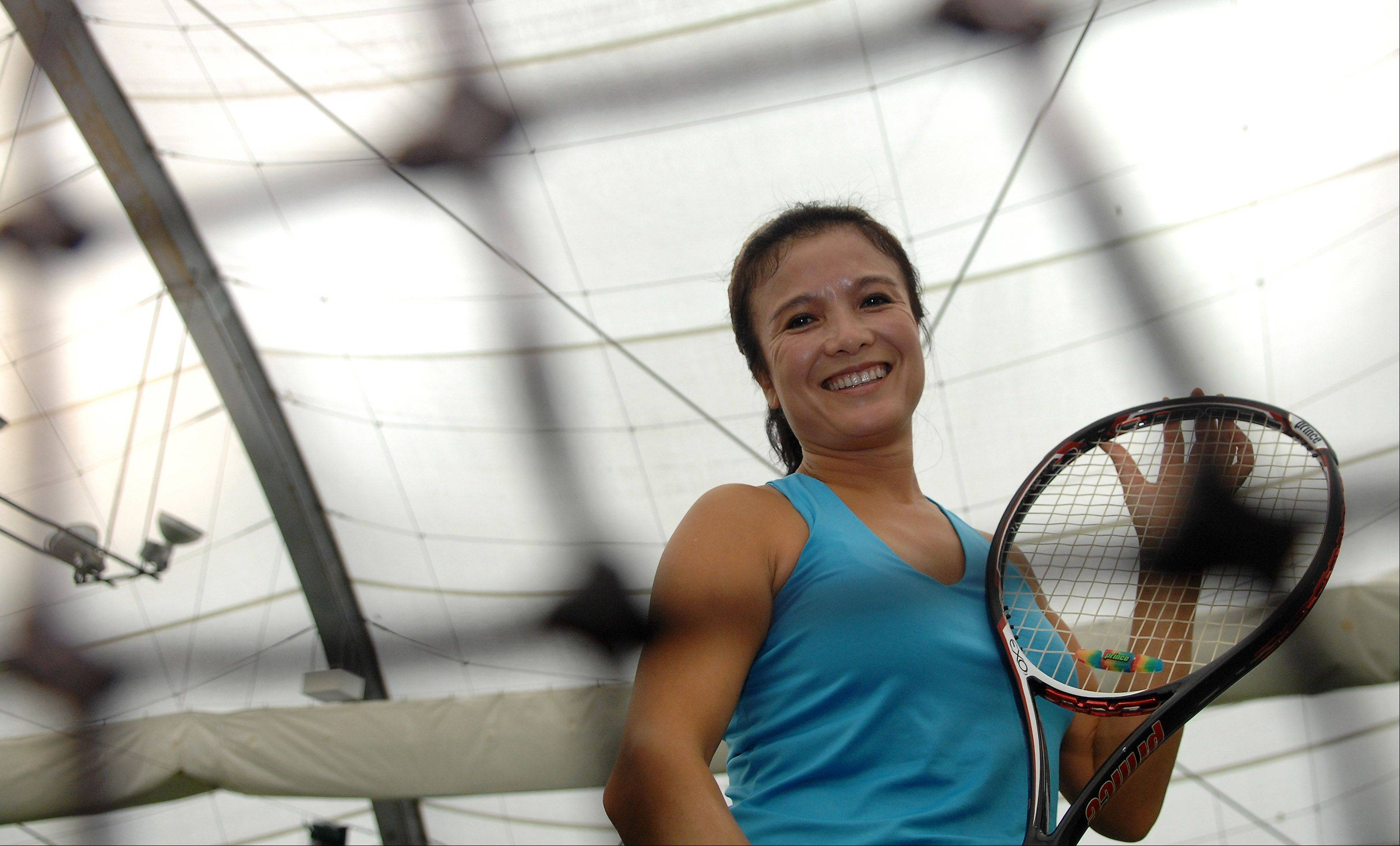 June Lynch, 45, is the number one tennis player at Elgin Community College. She picked up a tennis racket for the first time three years ago when she arrived at the community college from China.