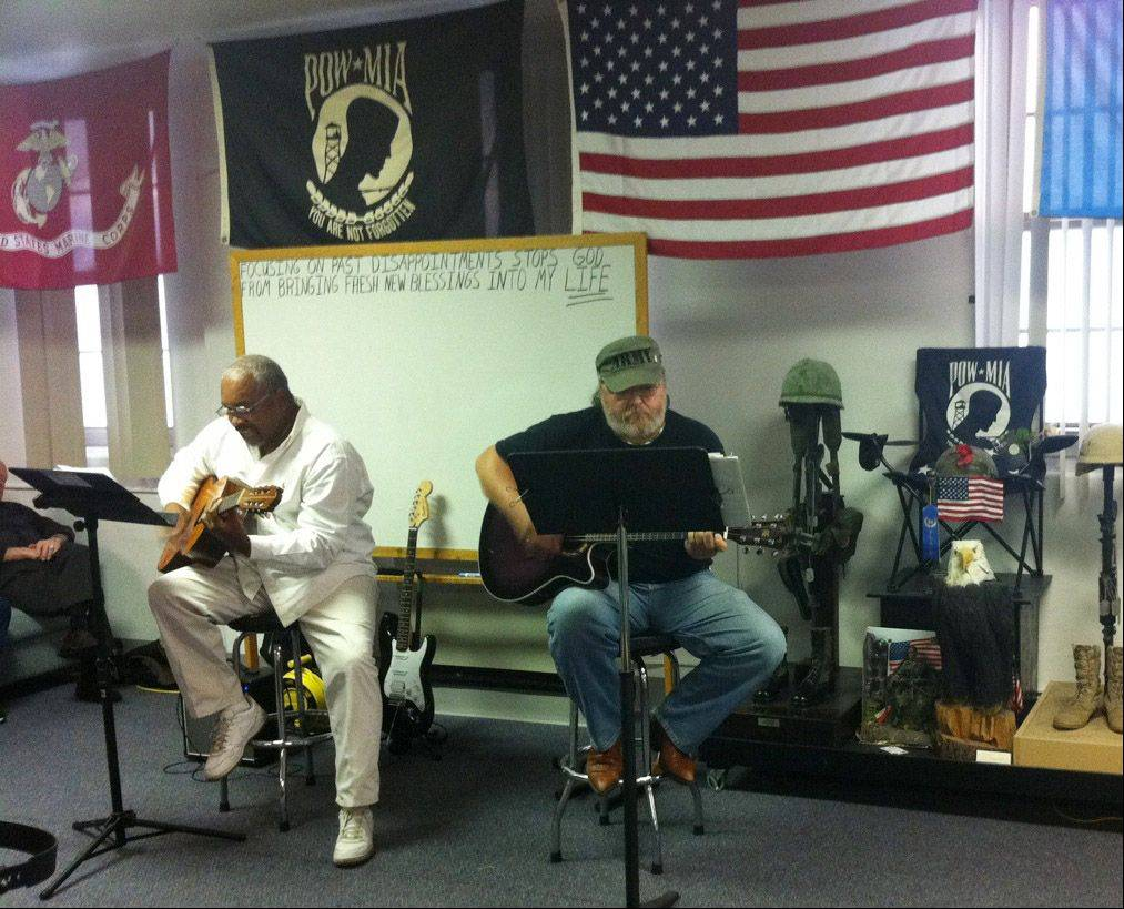 Former Marine James Cannon and Vietnam veteran Joe Klass play for the group, about 50 veterans and spouses, at the Captain James A. Lovell Federal Health Care Center in North Chicago.