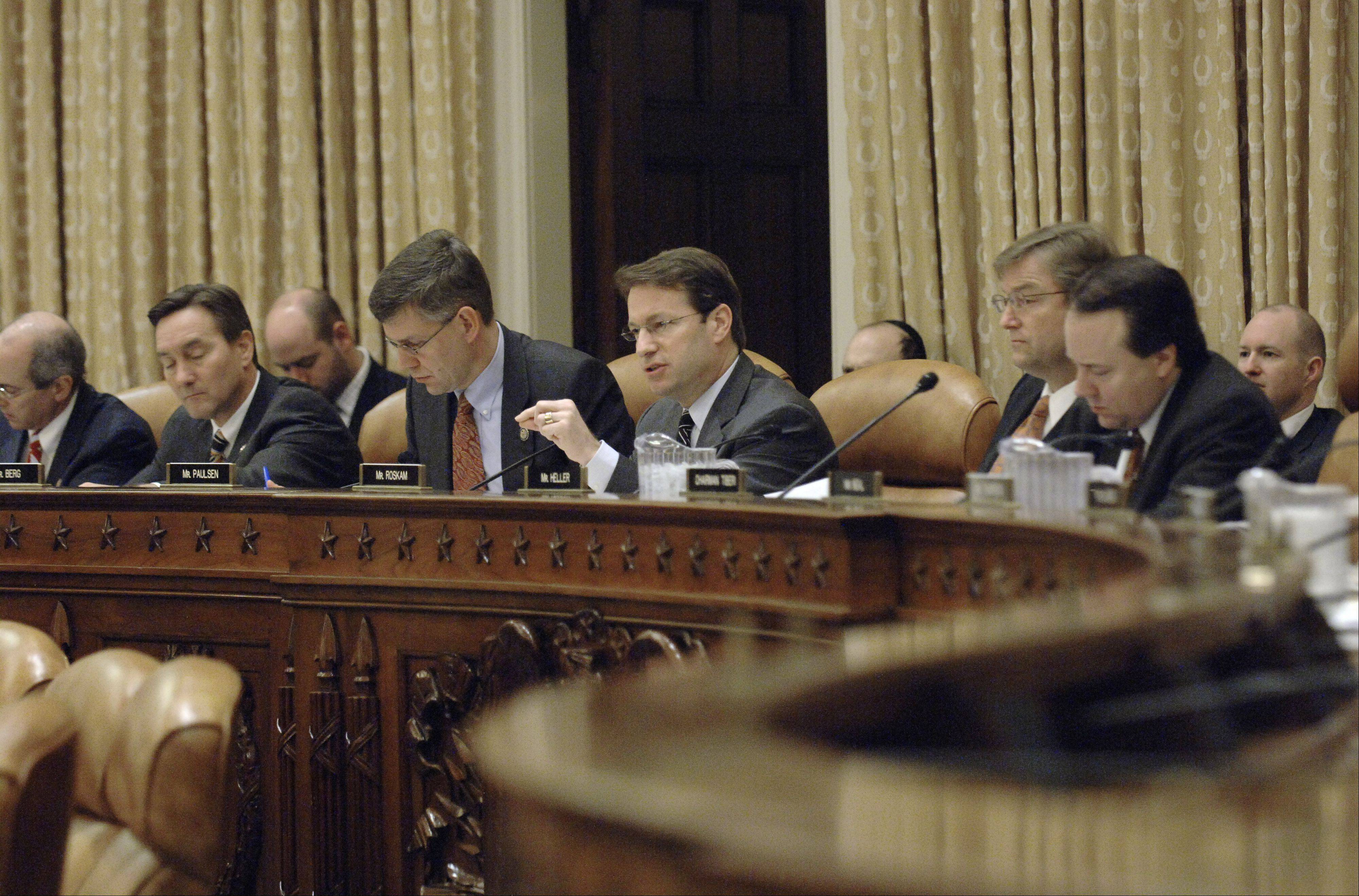 Chief Deputy Whip Peter Roskam, center, poses a question during a Ways and Means Committee meeting.