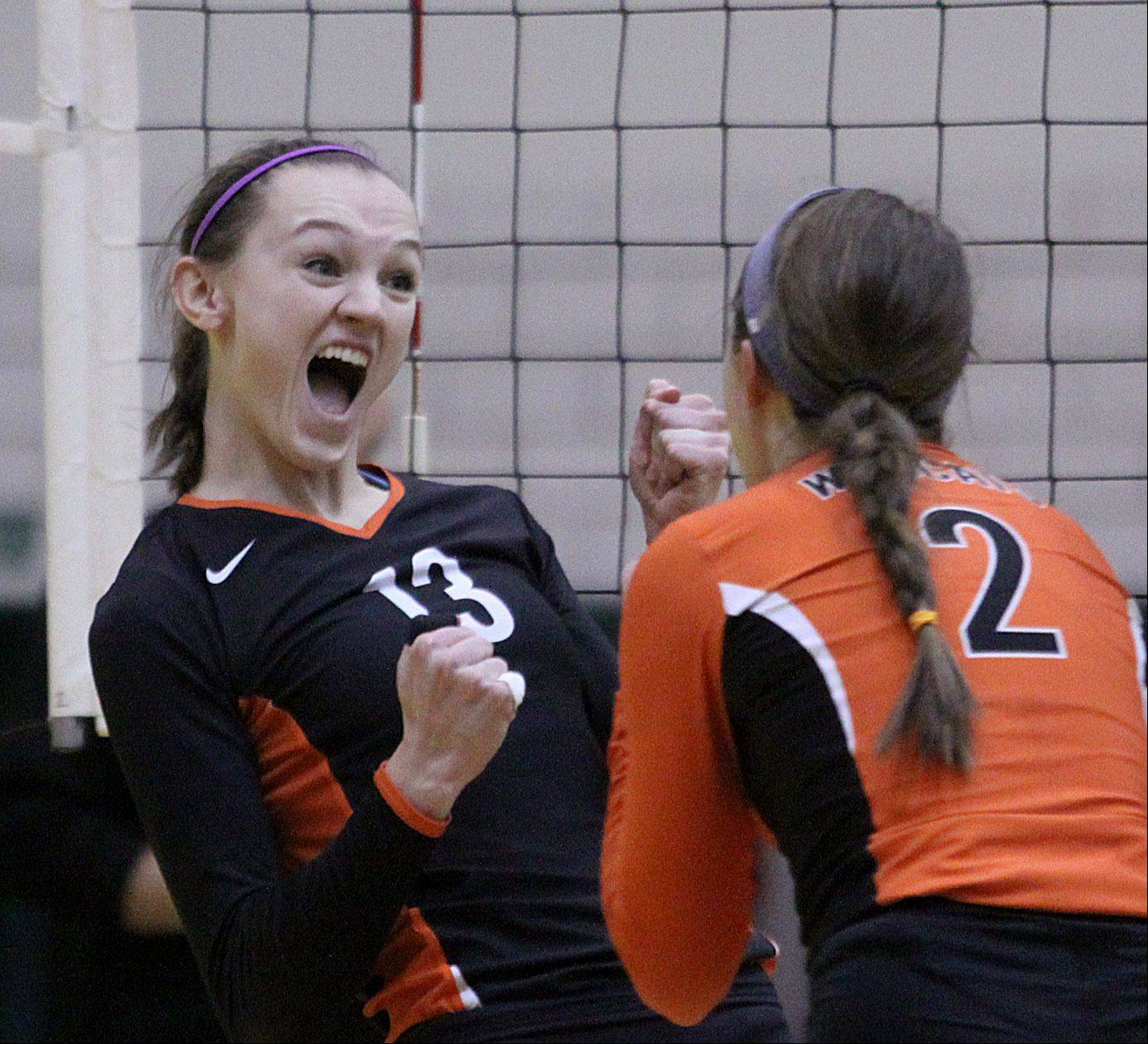 Libertyville's Julia Smagacz, left, celebrates with Kristen Webb during the Wildcats' sectional title victory over Palatine at Fremd High School.