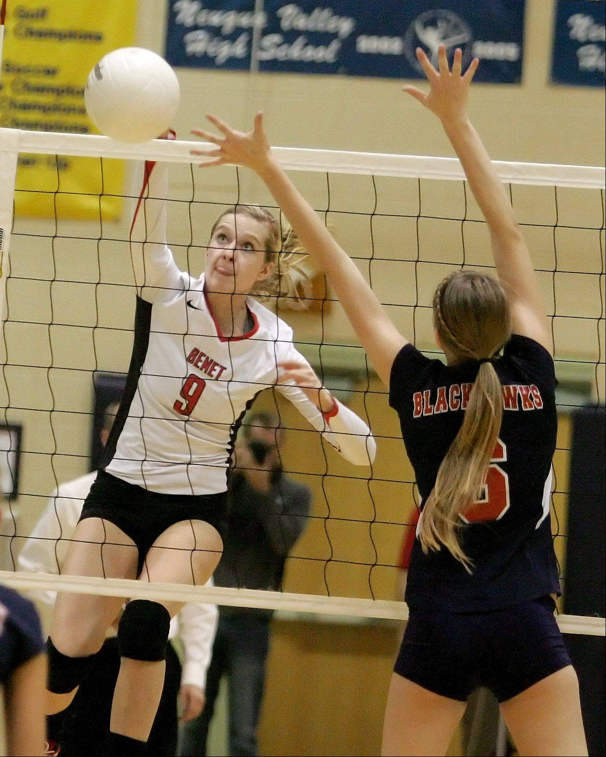 Abby Willett of Benet, tips the ball over the net in action against West Aurora during girls volleyball Neuqua Valley sectional semifinals in Naperville on Tuesday.