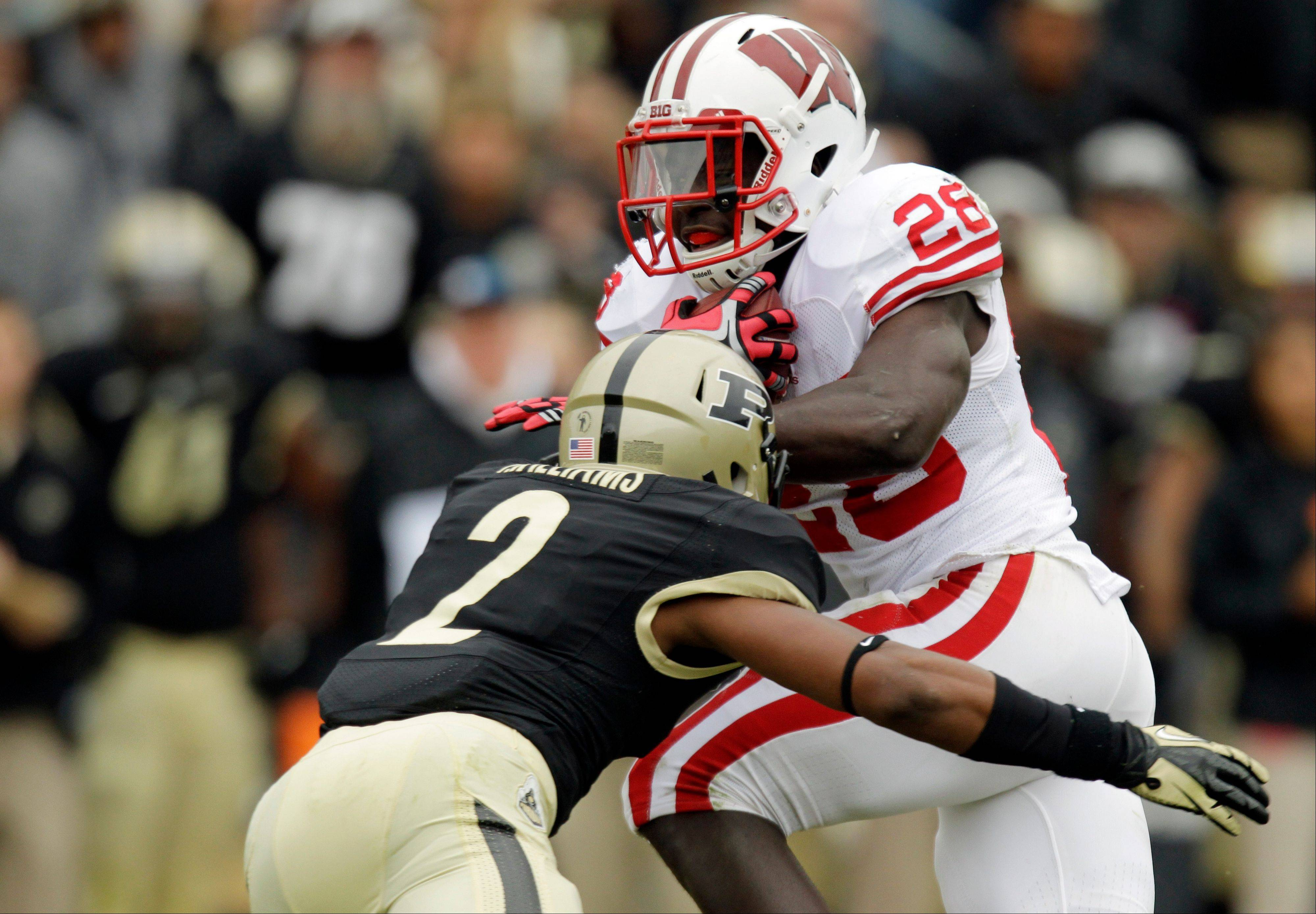 Wisconsin running back Montee Ball runs through the tackle of Purdue defensive back Frankie Williams during the first half in West Lafayette, Ind., earlier this season.