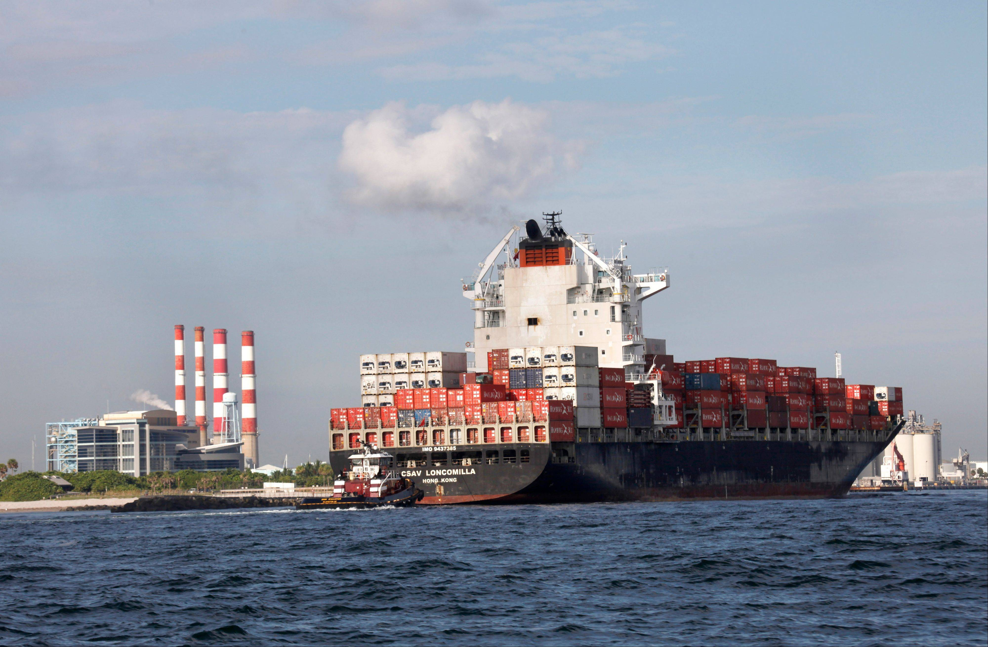 Associated Press/Sept. 27, 2012 A container ship passes the Florida Power & Light Port Everglades Plant on its way to unload its cargo at Port Everglades in Fort Lauderdale, Fla.