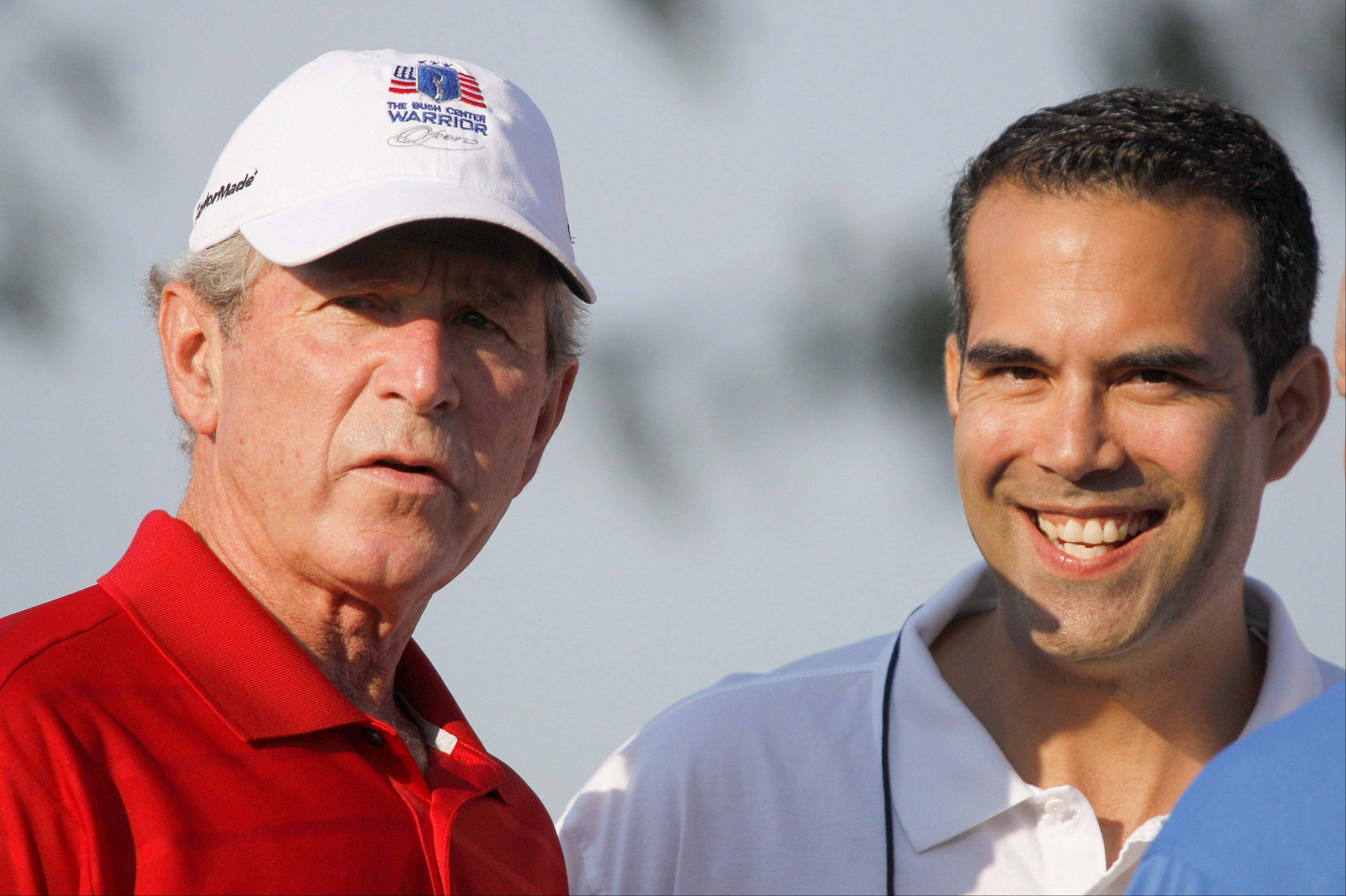 Associated Press/Sept. 24, 2012 George P. Bush, right, stands with his uncle former President George W. Bush, left, during the Bush Center Warrior Open in Irving, Texas.
