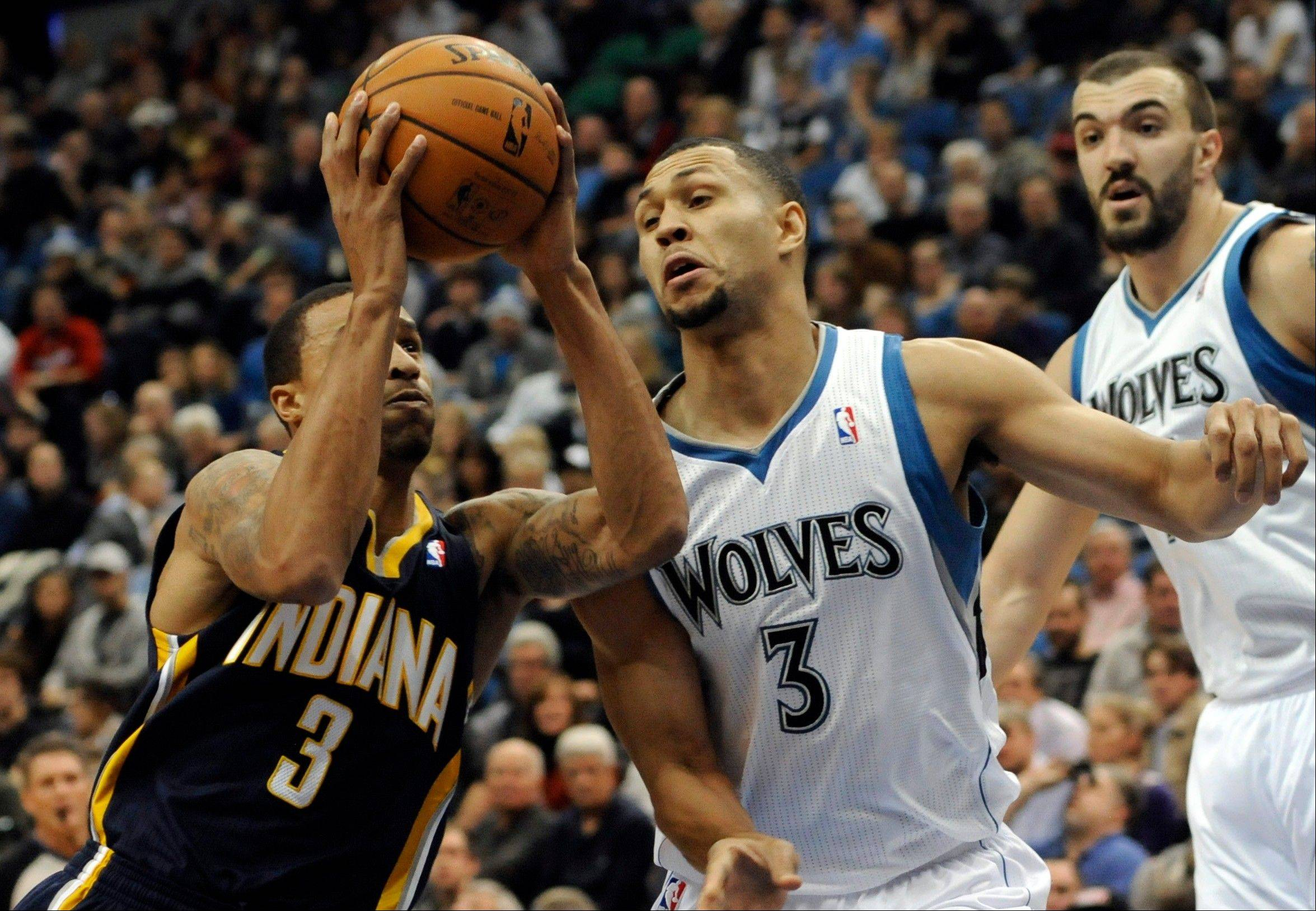 Indiana Pacers' George Hill drives as Minnesota Timberwolves' Brandon Roy, right, defends during the first half of an NBA basketball game Friday, Nov. 9, 2012, in Minneapolis. Hill led all scorers with 29 points. The Timberwolves won 96-94. (AP Photo/Jim Mone)