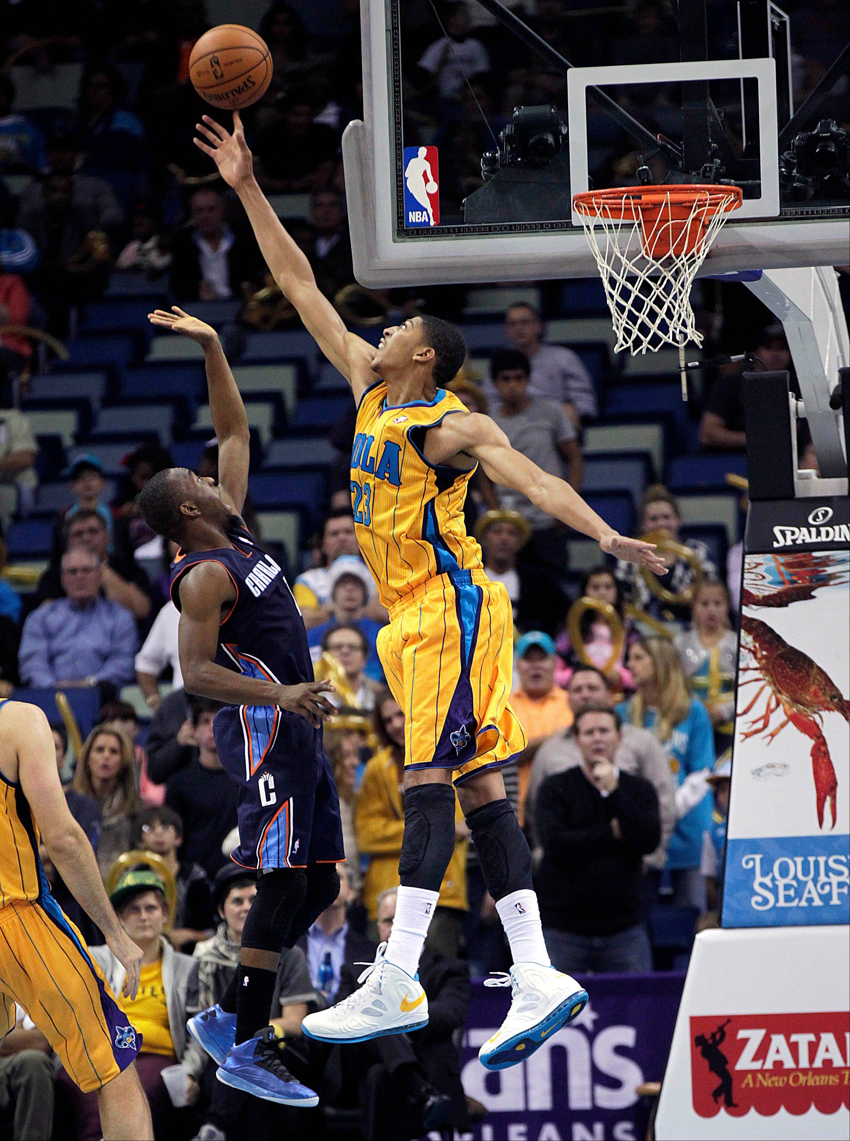 New Orleans Hornets power forward Anthony Davis (23) blocks a shot by Charlotte Bobcats power forward Bismack Biyombo in the second half of an NBA basketball game in New Orleans, Friday, Nov. 9, 2012. The Hornets won 107-99. (AP Photo/Gerald Herbert)