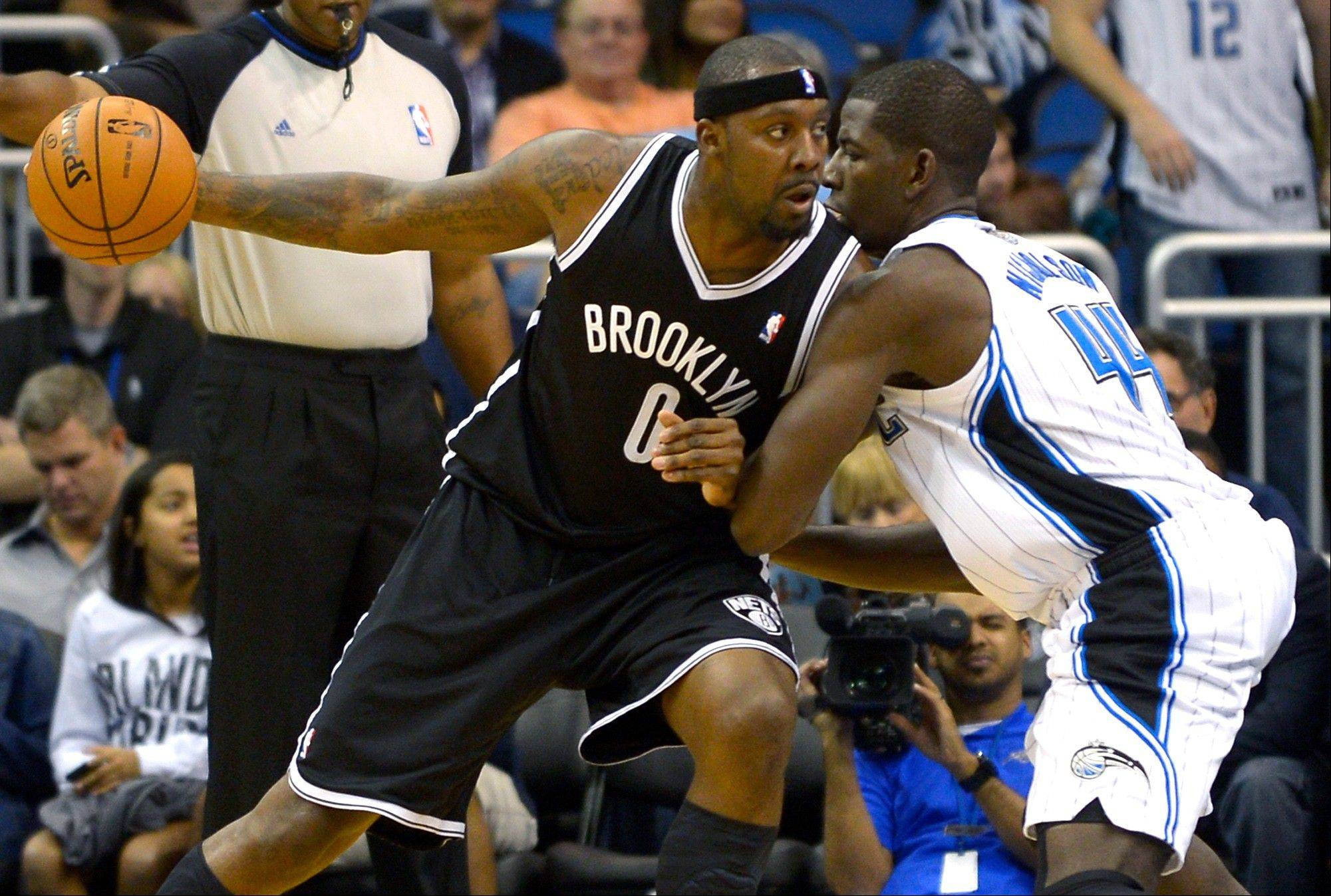 Brooklyn Nets center Andray Blatche drives to the basket against Orlando Magic forward Andrew Nicholson Friday during the second half in Orlando, Fla. The Nets won 107-68.