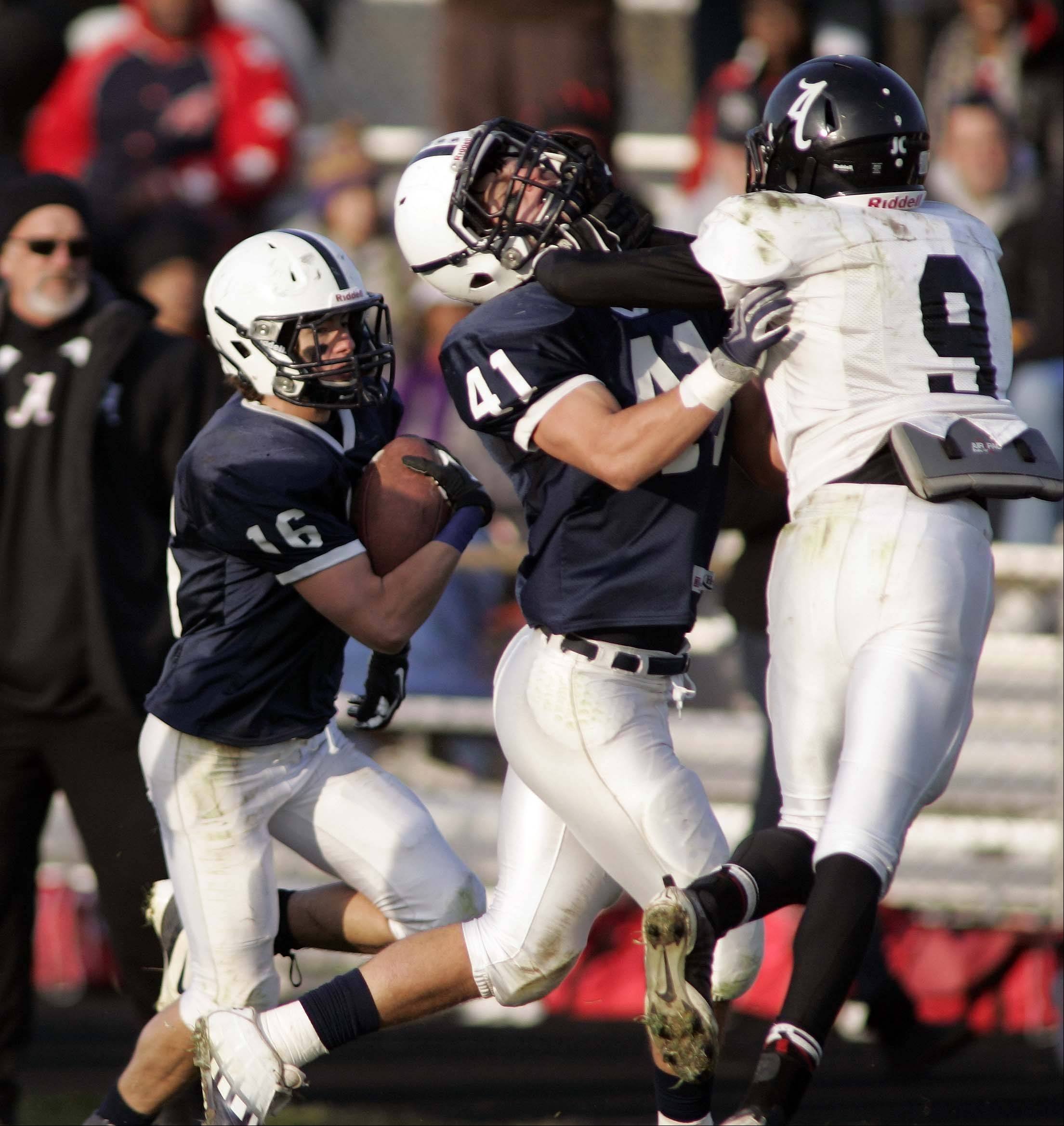 Cary-Grove�s Zach Marszal (41) puts a block on Rockford Auburn�s Corey Jefferson (9) to give Cary-Grove�s Kaene Connington some running room during the first round of the Class 6A playoffs. Cary-Grove hosts Crystal Lake Centrak Saturday at 1 p.m. in the quarterfinal round.