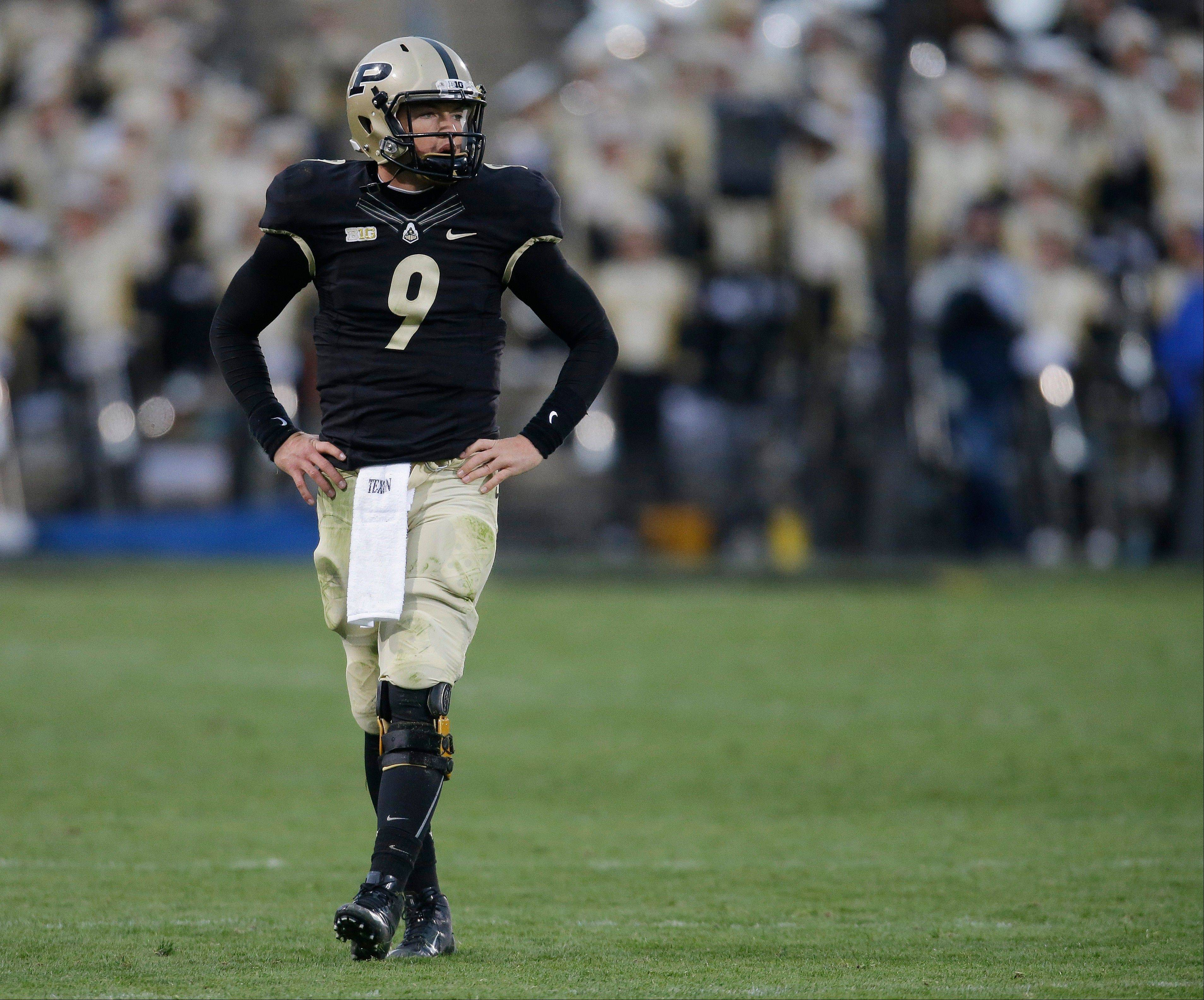 Purdue quarterback Robert Marve walks off field Saturday following a Purdue turnover during the second half against Penn State in West Lafayette, Ind. Penn State defeated Purdue 34-9.