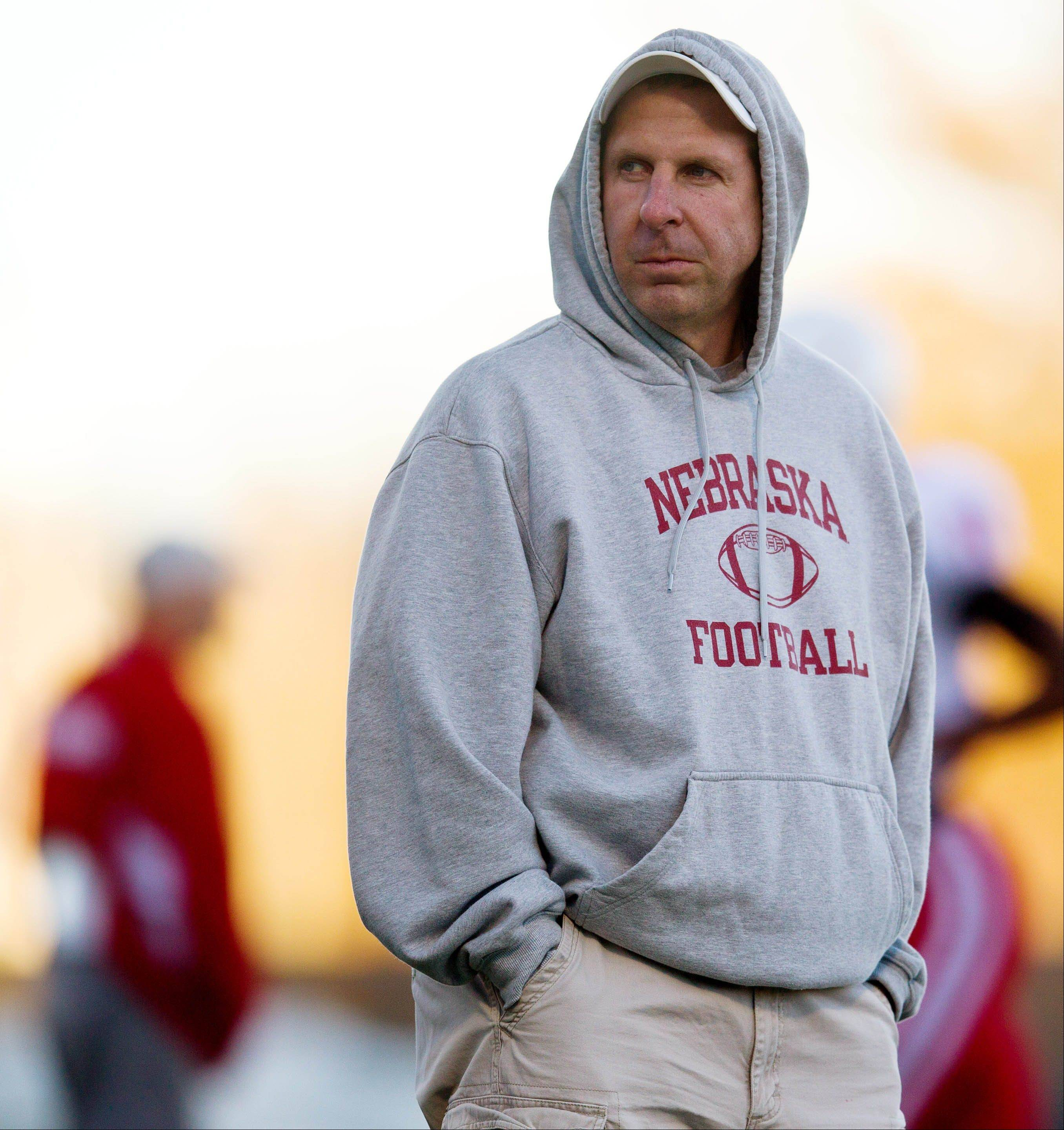 Nebraska football coach Bo Pelini watches players warm up Tuesday during practice in Lincoln. The Huskers� minus-1 turnover margin is last in the Big Ten and 106th in the nation. Of 14 other teams with the same or worse margin, only Oklahoma State has a winning record.