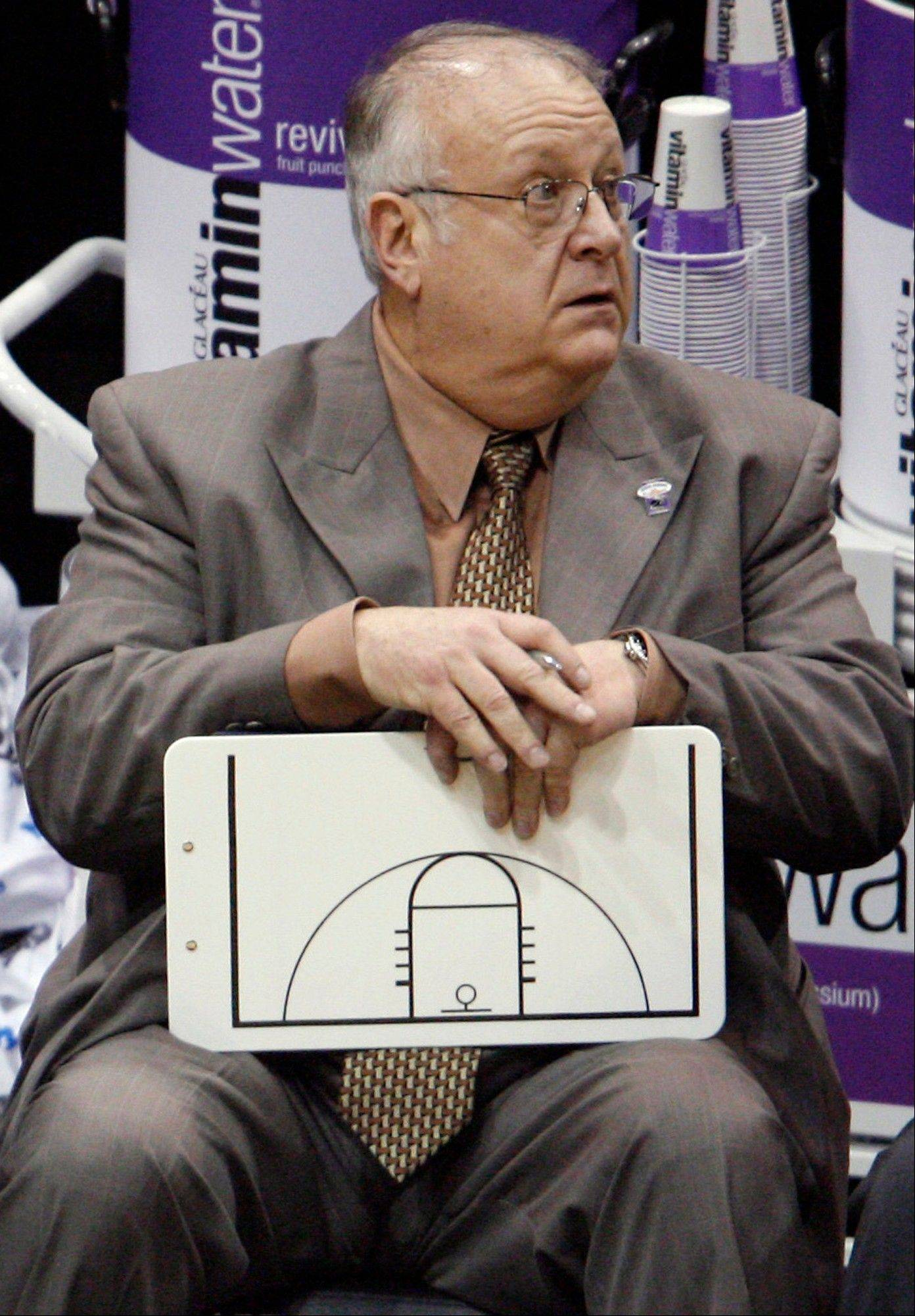 Syracuse assistant basketball coach Bernie Fine sits on the bench at the end an NCAA West Regional semifinal college basketball game against Butler in Salt Lake City. Federal authorities have dropped their investigation into sexual abuse claims that cost Fine his job. After a probe spanning nearly a year, U.S. Attorney Richard Hartunian said Friday there was no evidence to support claims that Fine had molested a boy in 2002 in a Pittsburgh hotel room.