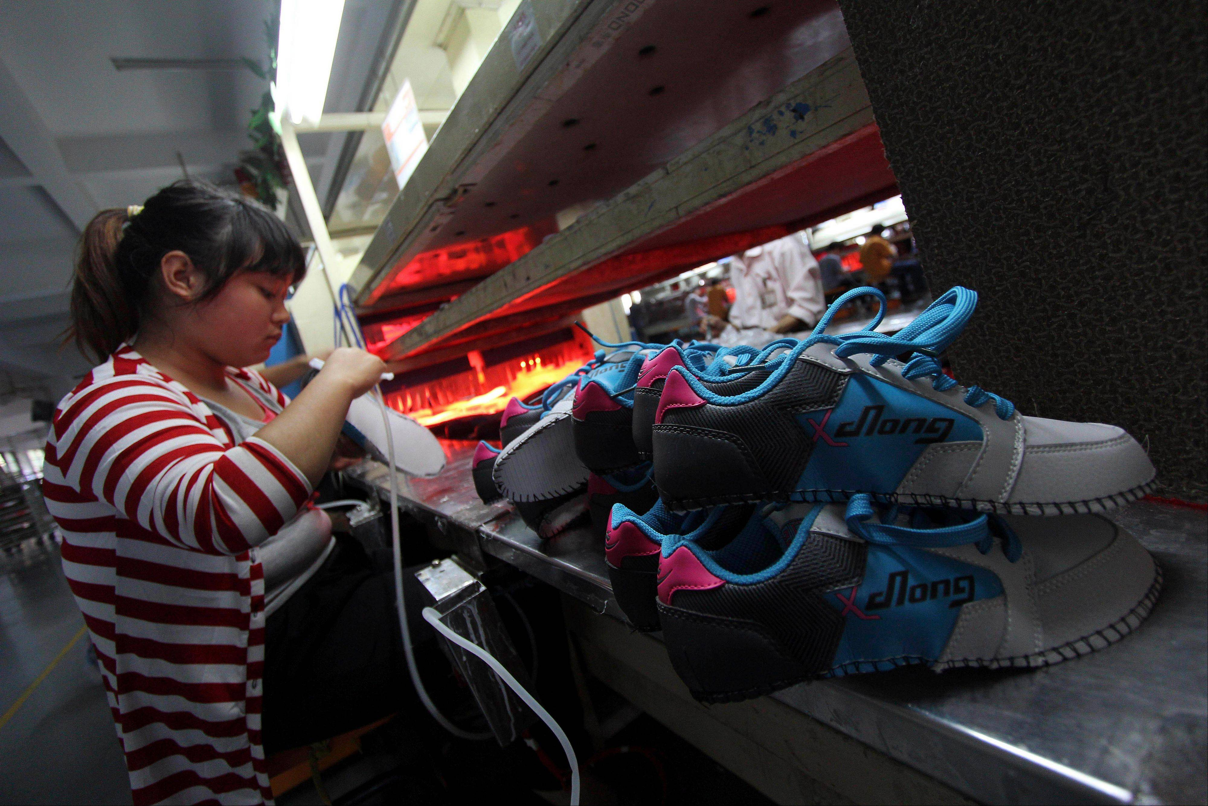 China's auto sales, consumer spending and factory output improved in October in a new sign of economic recovery as the Communist Party prepared to install a new generation of leaders. Growth in factory output accelerated to 9.6 percent over a year earlier from the previous month's 9.2 percent, the government reported Friday.