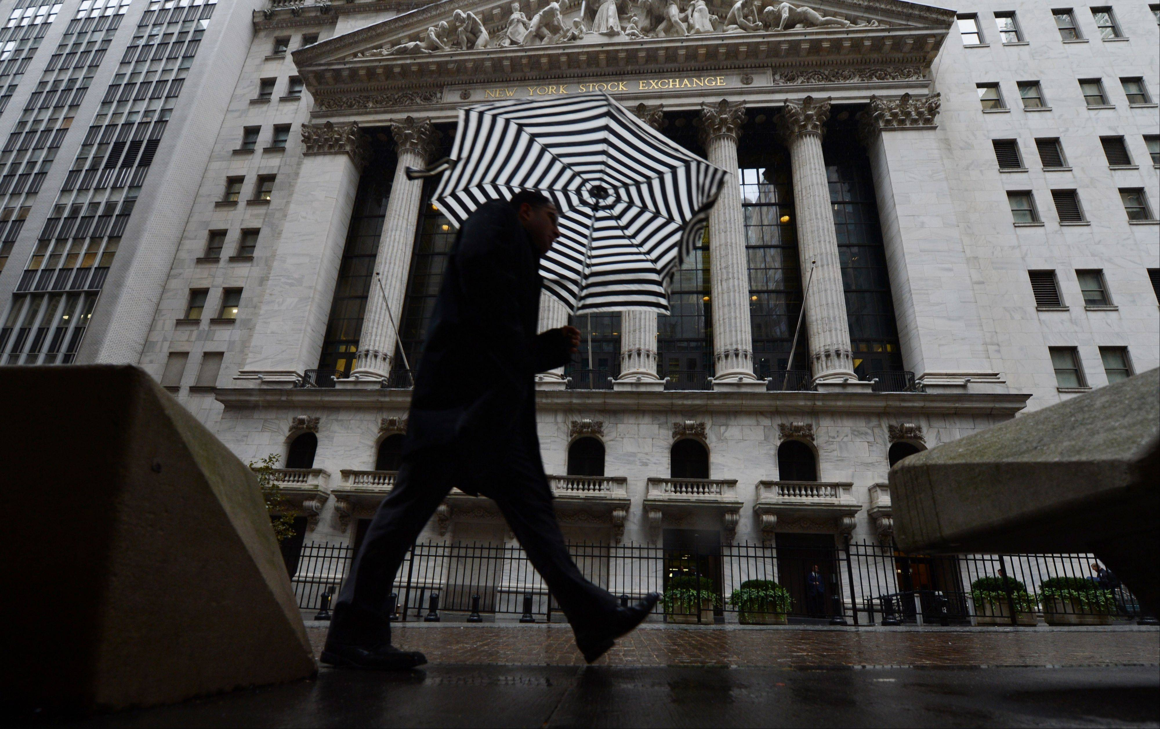 A pedestrian walks past the New York Stock Exchange The price of oil tumbled nearly 5 percent Wednesday, its biggest decline of the year, as traders shifted their focus back to the struggles of the global economy.