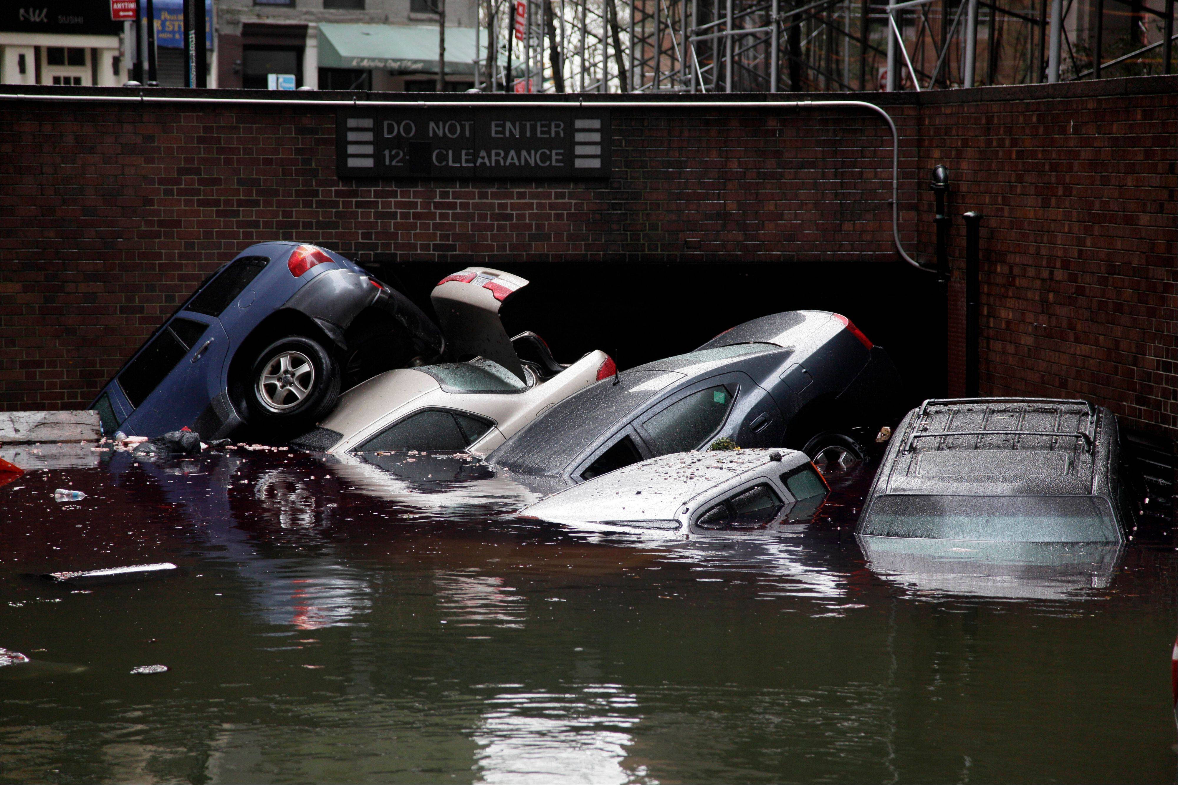 Cars are submerged at the entrance to a parking garage in New York's Financial District in the aftermath of superstorm Sandy. Alarming claims that hundreds of thousands of flood-damaged cars from Superstorm Sandy will inundate the used car market aren�t backed up by insurance company claim data, The Associated Press has found. The dire predictions come mostly from companies that track vehicle title and repair histories and sell those reports.