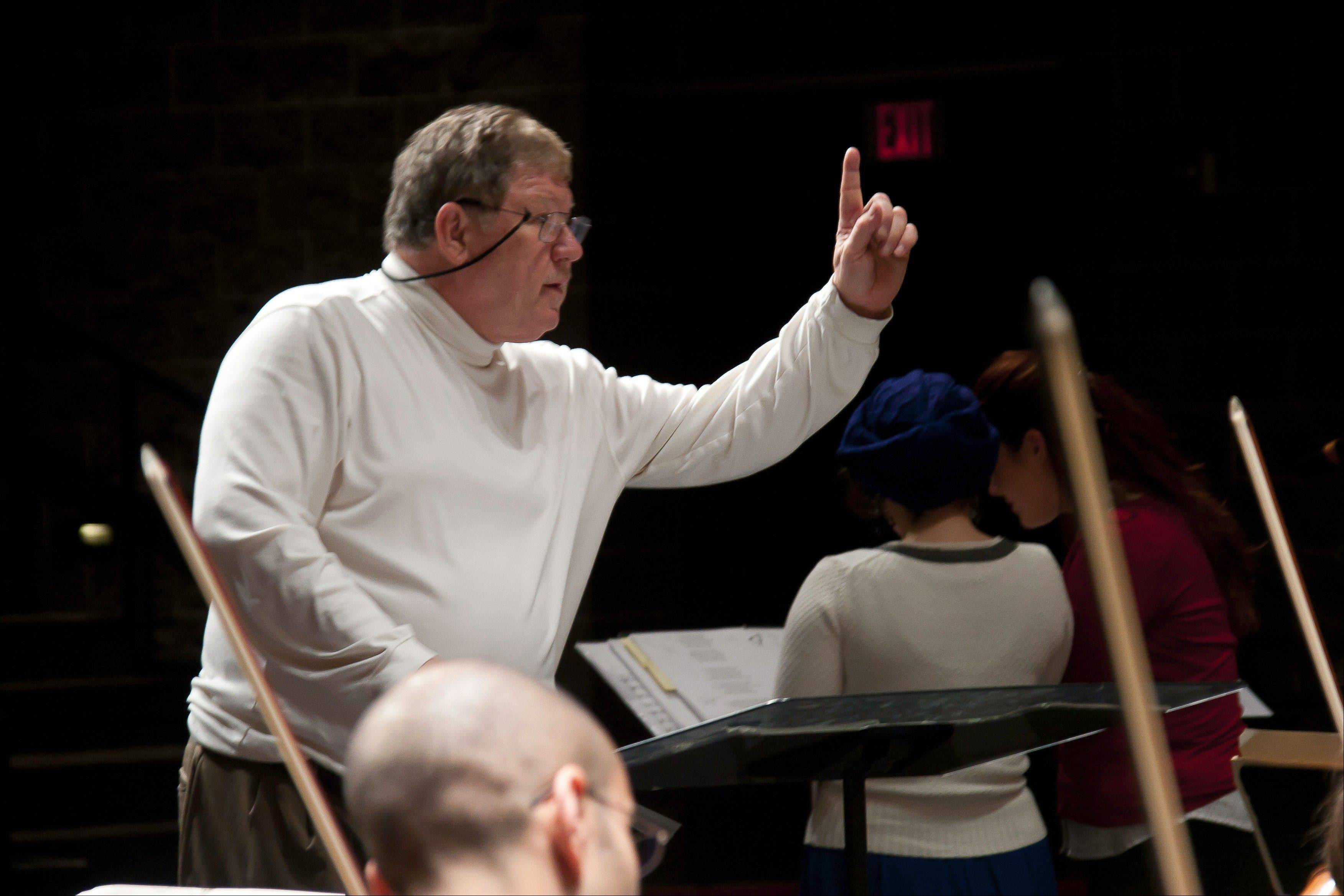 Maestro Verne Schwager conducts the Northwest Festival Orchestra in rehearsal.