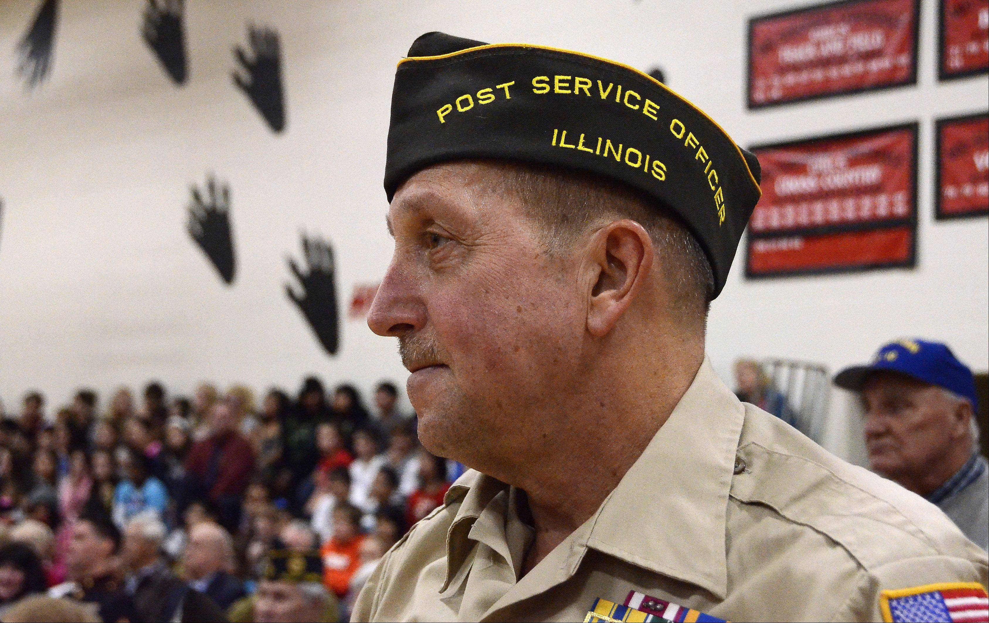 Standing Friday at MacArthur Middle School in Prospect Heights for recognition of his service, Dutch DeGroot of Mount Prospect is an Army veterean of Vietnam and the Air Force in Desert Storm.