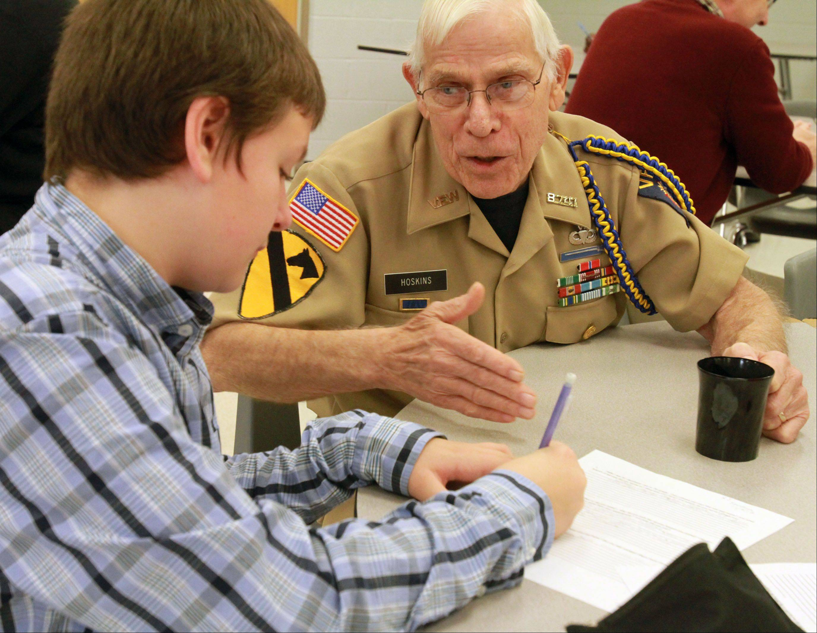 Seventh-grade student RJ Jacobson interviews Elmer Hoskins of Wildwood of VFW Post 8741, for his social studies class, after a Veteran's Day breakfast and program at Hawthorn Middle School in Vernon Hills.