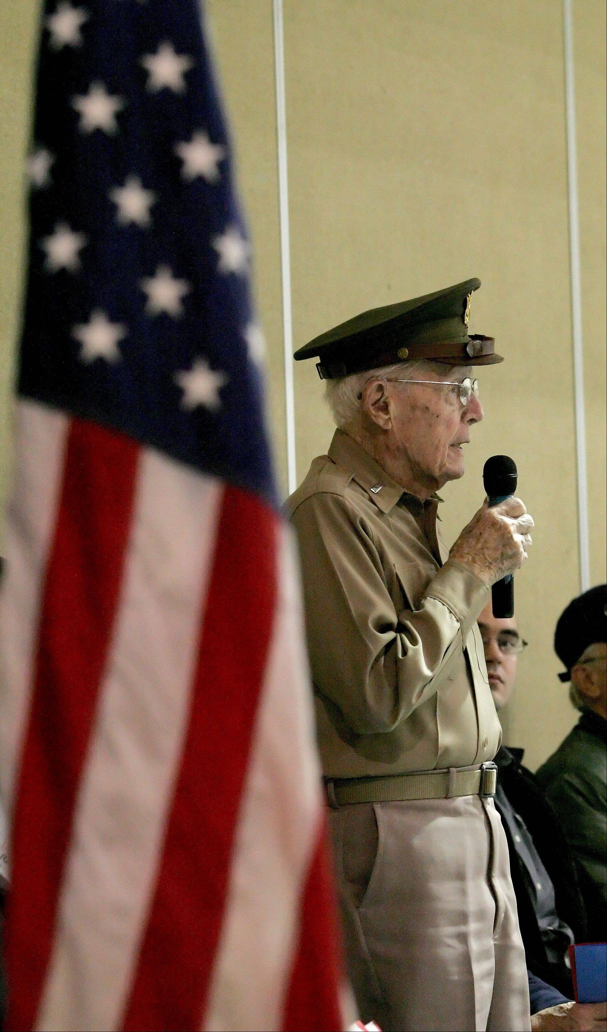 WWII veteran, George Kleinwachter of Warrenville, introduces himself during a Veterans Day program at Johnson Elementary School in Warrenville.