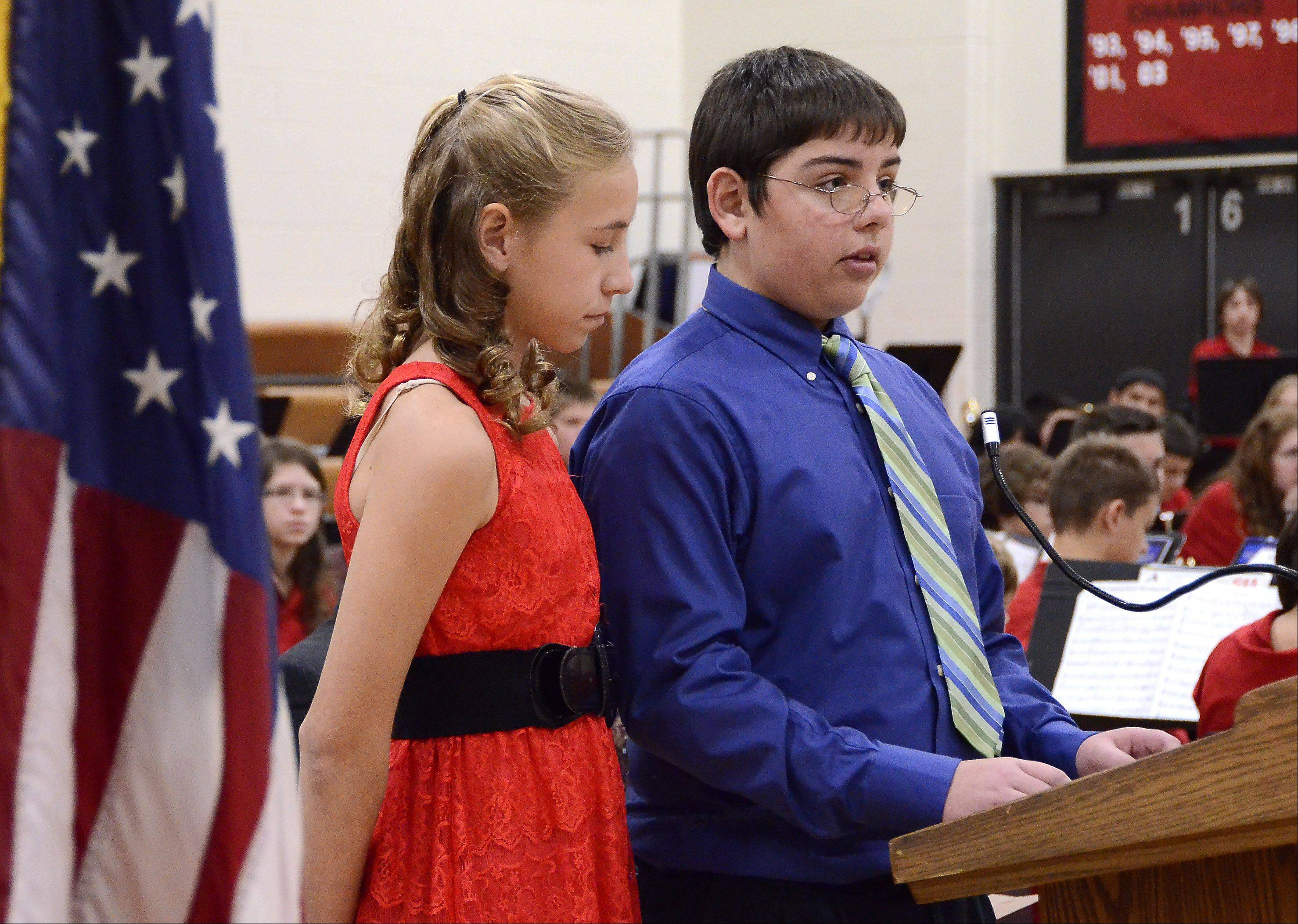 Eighth graders Ashley Boldt of Arlington Heights and Joey Knapik of Prospect Heights speak of the flag at the Veterans Day assembly Friday at MacArthur Middle School in Prospect Heights.