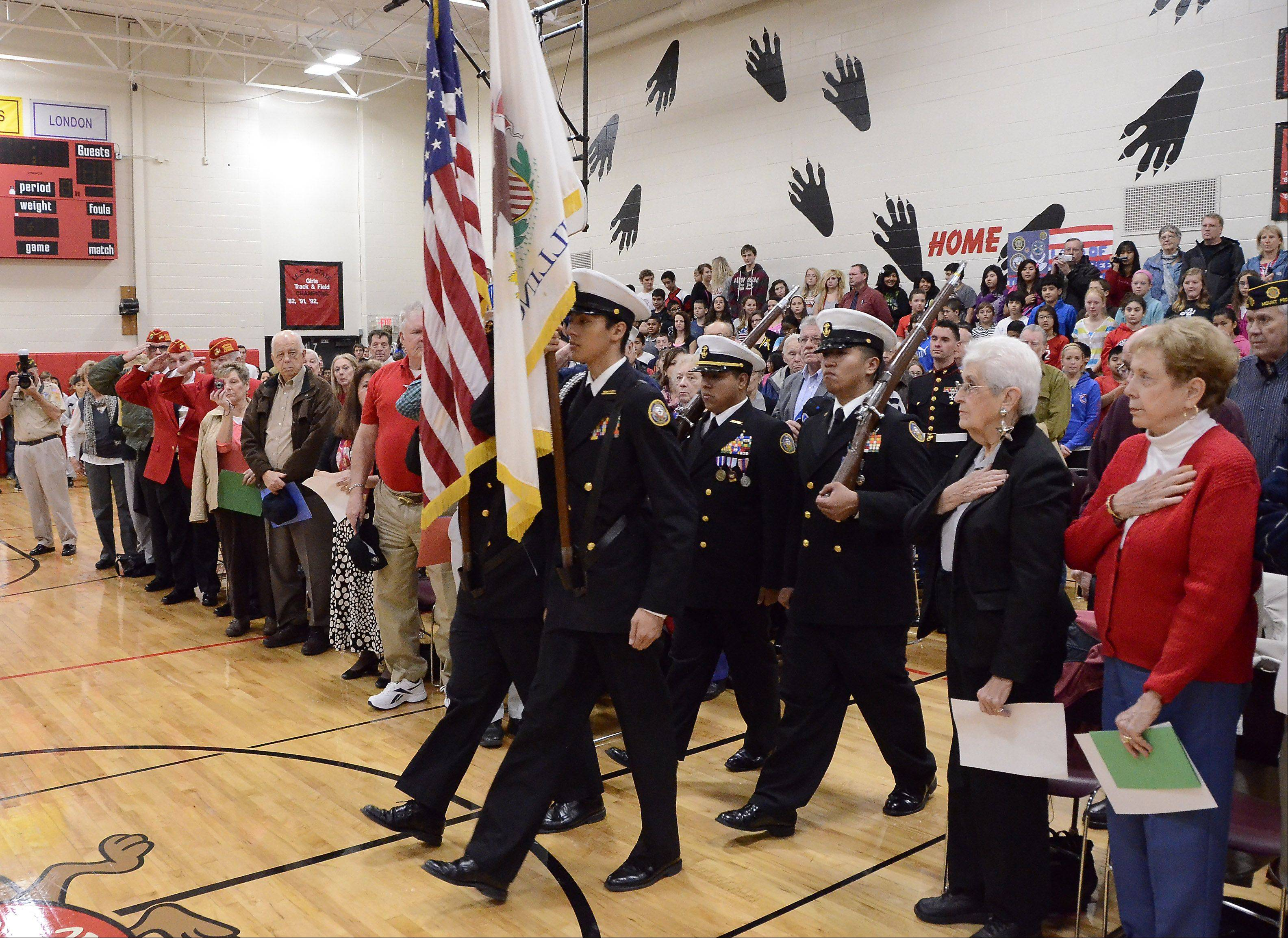 The Wheeling High School ROTC Cadets present the colors at the Veterans Day breakfast and assembly Friday at MacArthur Middle School in Prospect Heights.