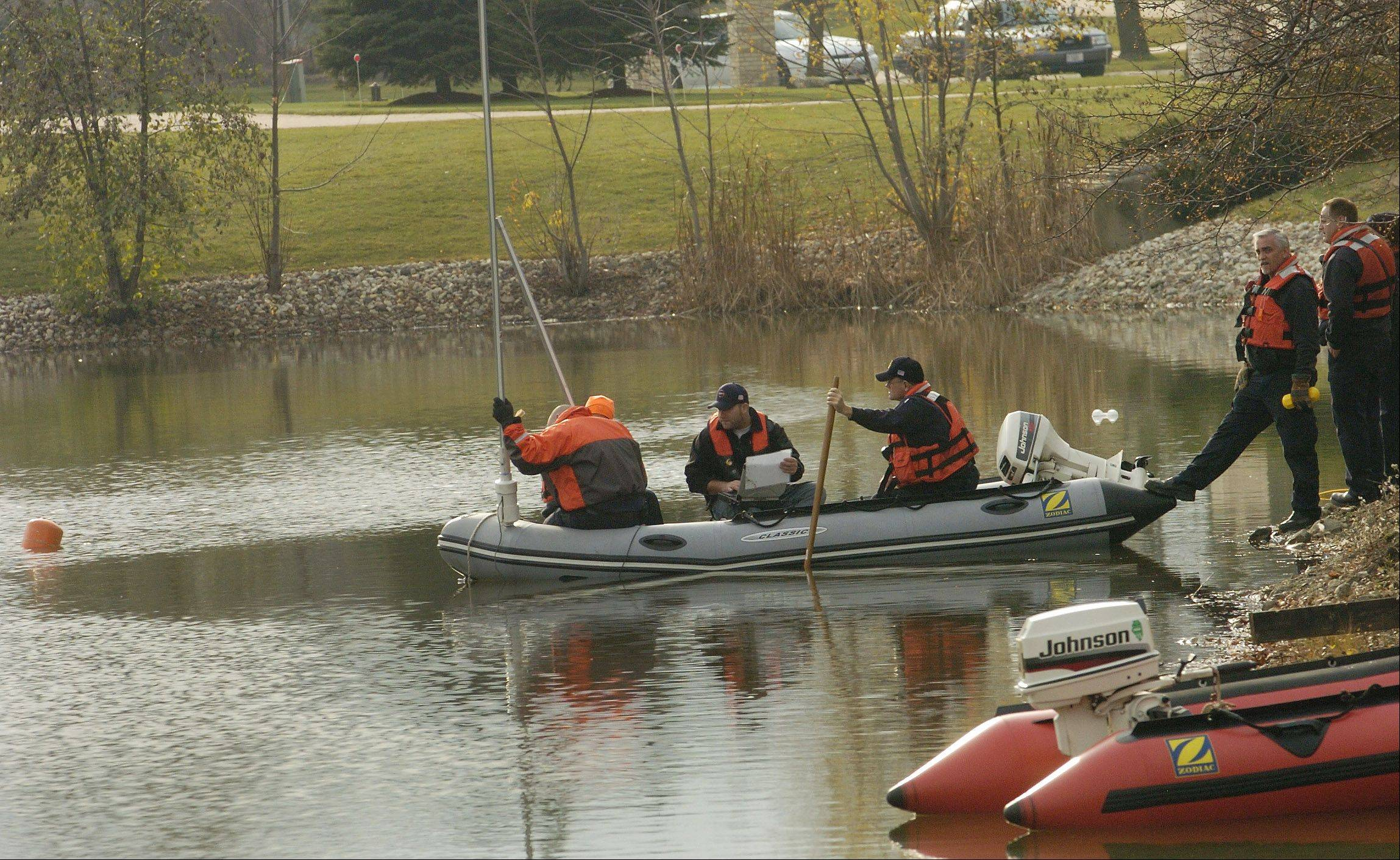 Divers search a second pond on Spring Creek Drive in South Barrington.