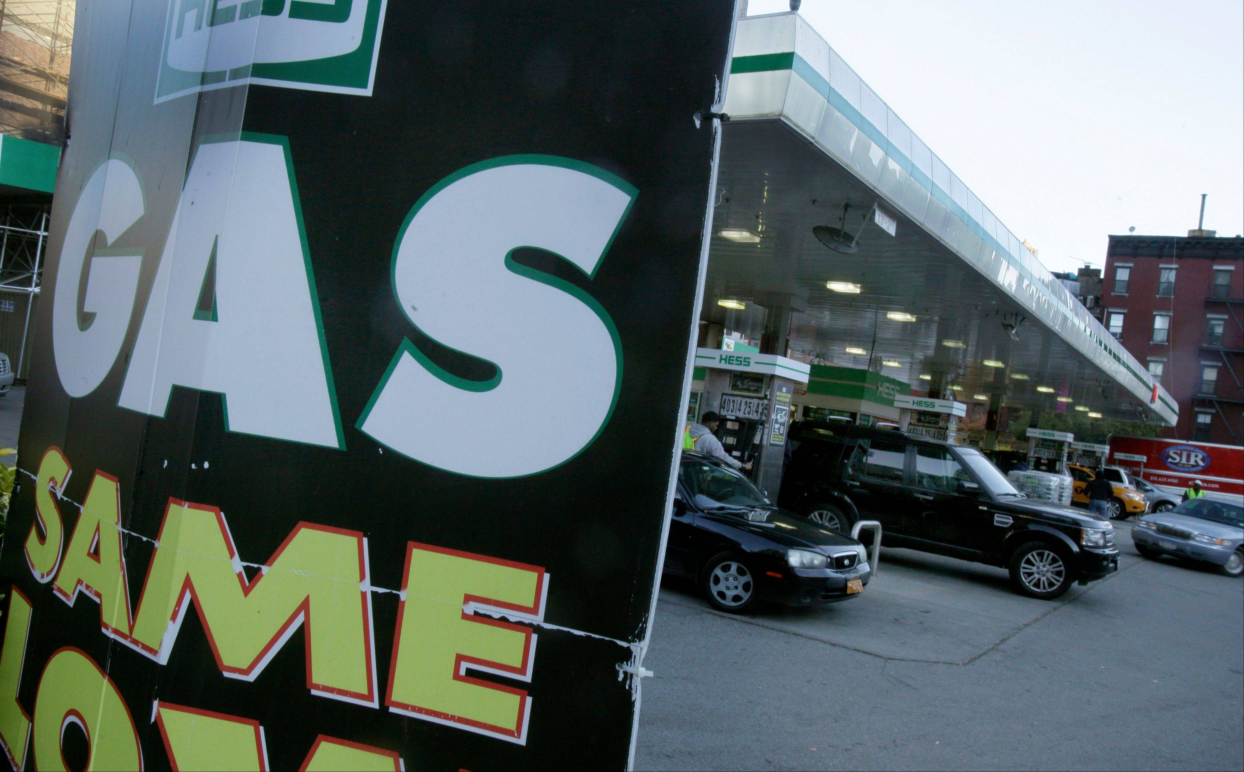 Drivers fill-up at a station in New York, Friday, Nov. 9, 2012. A new gasoline rationing plan that lets motorists fill up every other day went into effect in New York on Friday morning. Police were at gas stations to enforce the new system in New York City and on Long Island.