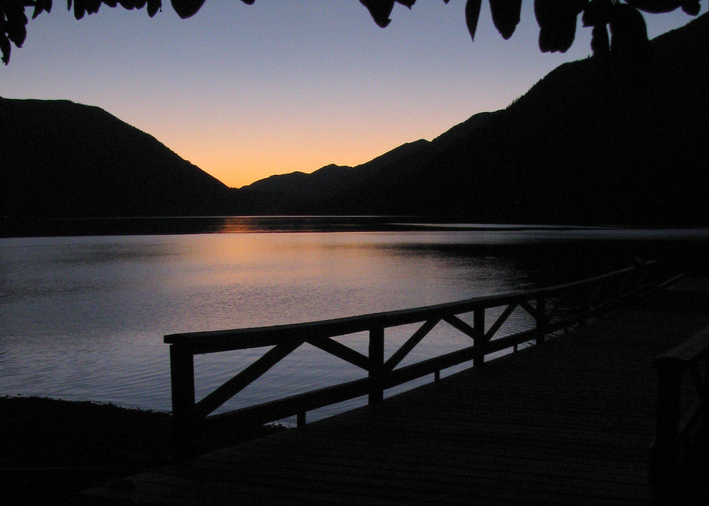 The last light of the setting sun places a serene calm over Lake Crescent in Washington State.