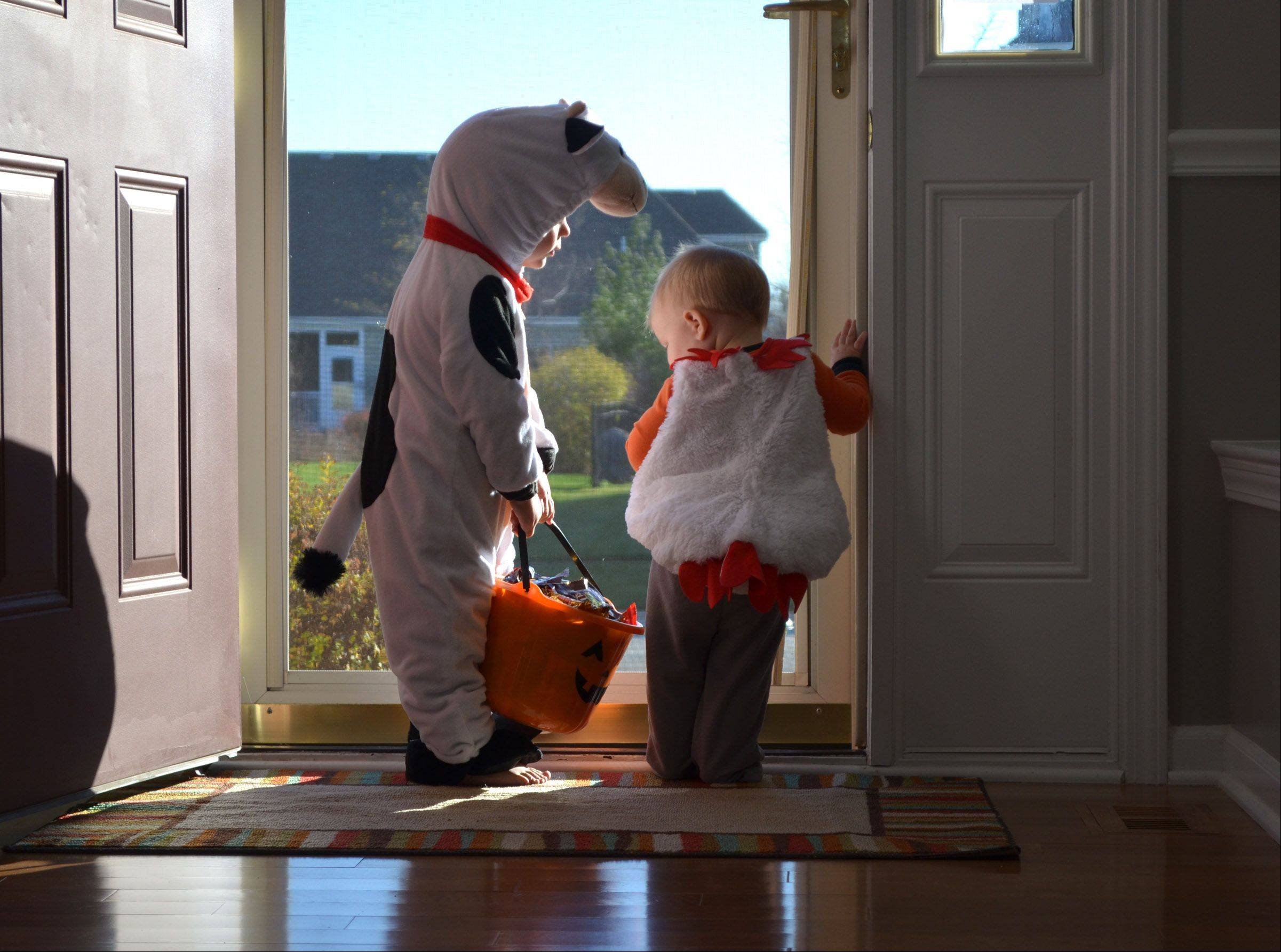 My daughter, Jessica, focused on her boys Colin & Owen as they waited for Trick or Treaters at their front door. It really is better to give than receive.