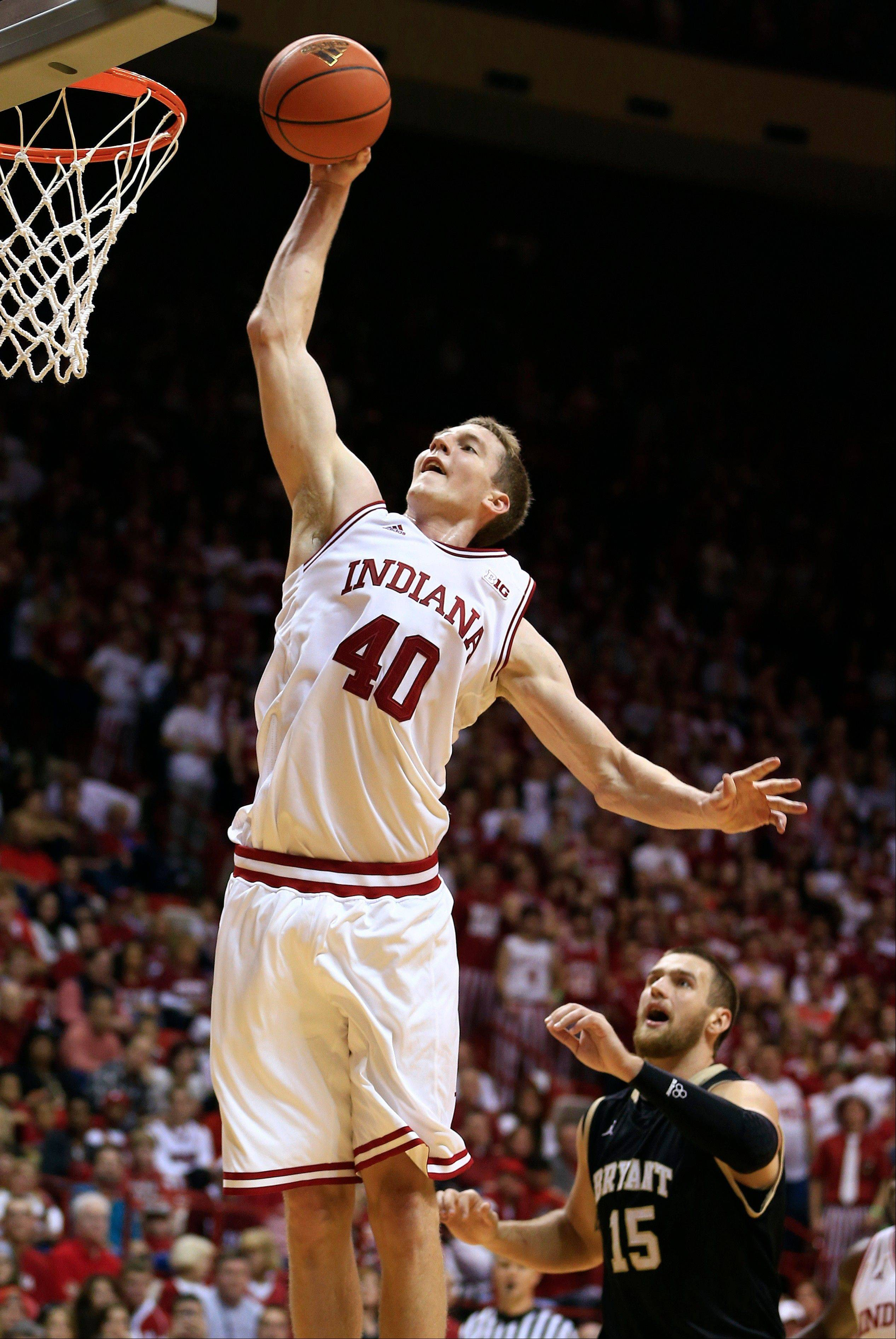 Indiana's Cody Zeller dunks against Bryant's Vlad Kondratyev Friday during the second half in Bloomington, Ind. Indiana won 97-54.