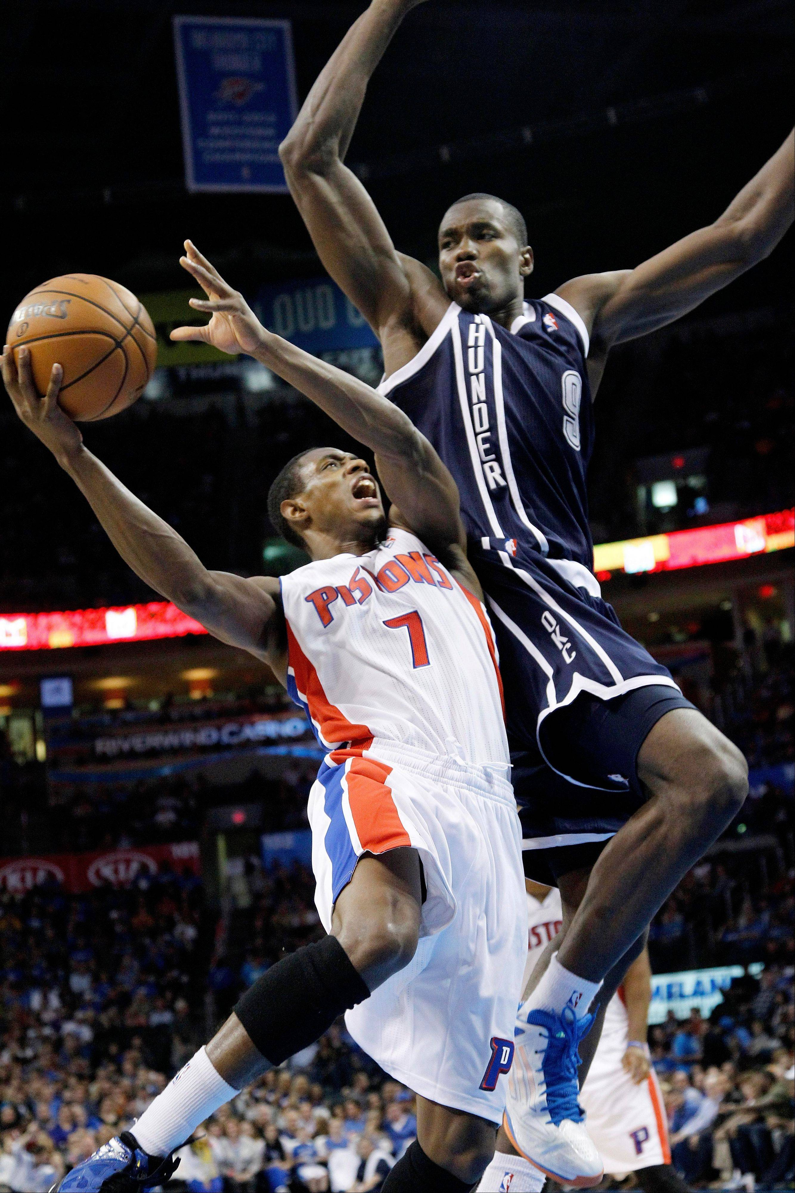 Detroit Pistons guard Brandon Knight (7) is fouled by Oklahoma City Thunder forward Serge Ibaka (9) during the second quarter of an NBA basketball game in Oklahoma City, Friday, Nov. 9, 2012.