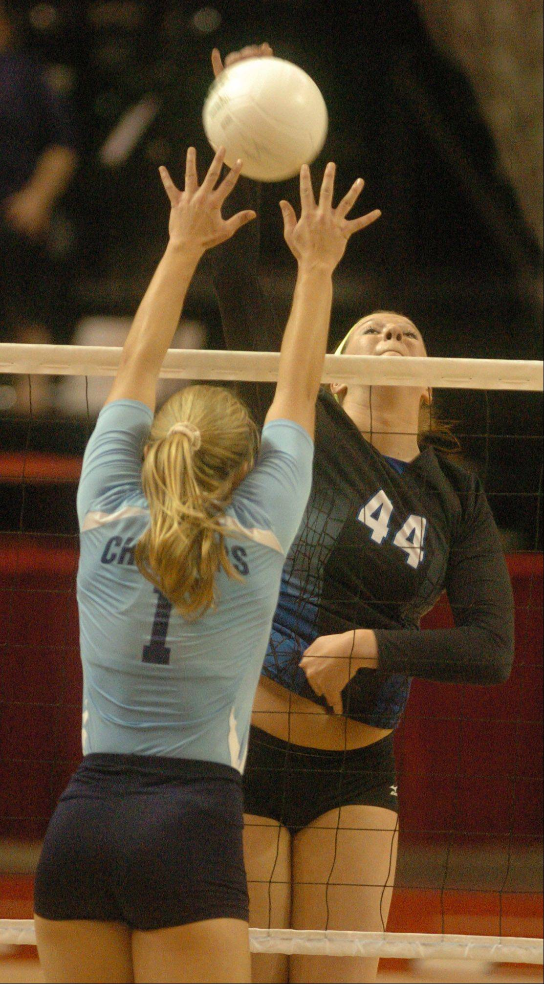 Maddie Haggerty of St. Francis goes up for a spike during the class 3A state semifinal between St. Francis and Champaign Centennial in Bloomington-Normal Friday. Libby Cocagne of Centennial was trying to block the shot.